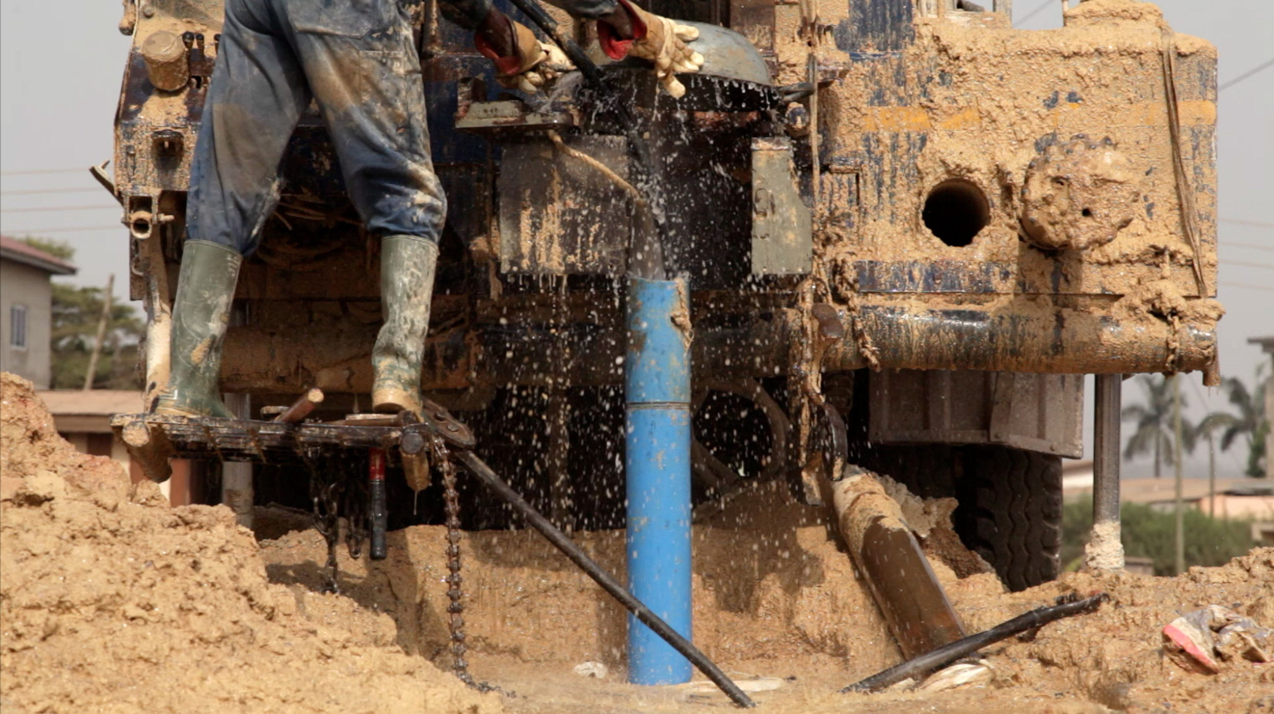 A JOISSAM employee works on a borehole in Kumisa, Ghana. © Laura Elizabeth Pohl