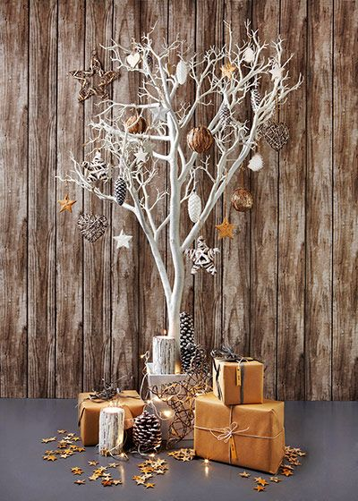 Using fallen branches, or clippings, is a wicked way to reduce waste and avoid any more trees being cut down. Plus you can get creative. Remember to use biodegradable glitter!