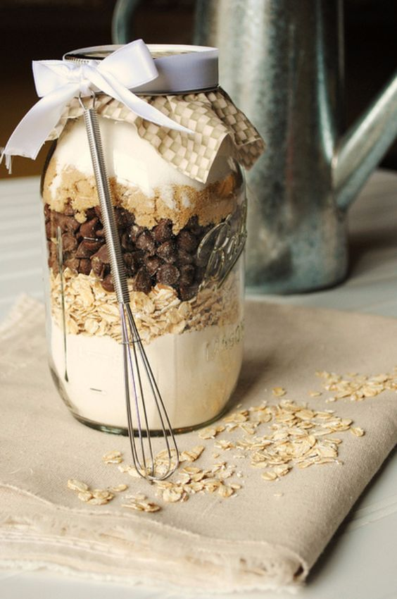 Why not give the gift of food? There are so many tasty mason jar recipes out there, and this website lists 32 of them. It's a cute waste free alternative.