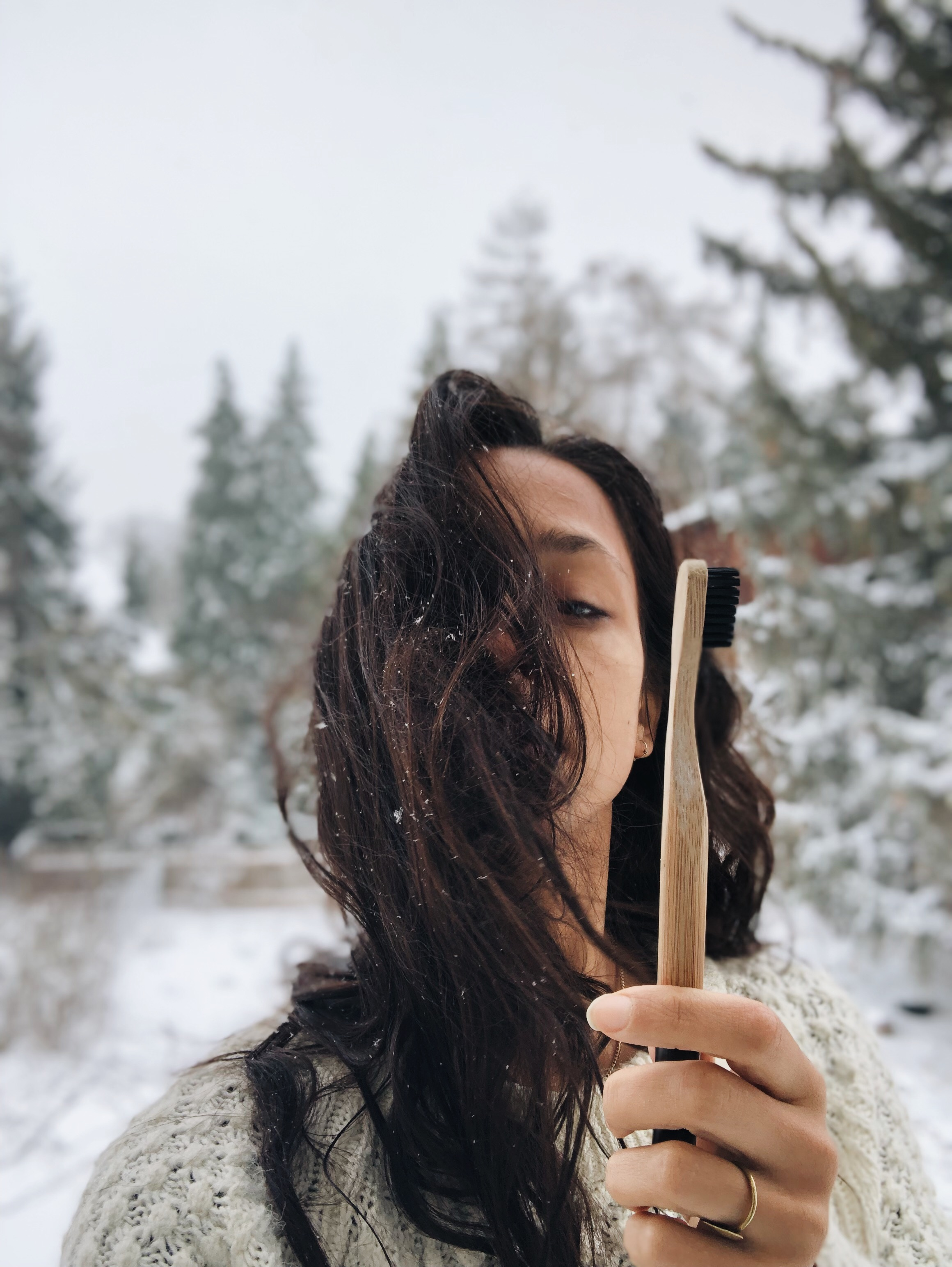 Holding my bamboo and charcoal toothbrush proudly in the snow like a bellend.