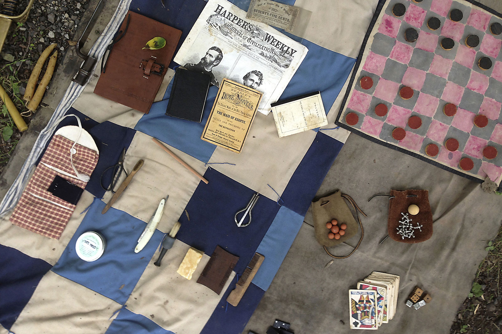 Small articles of humanity such as a pack of playing cards, a journal or photos from home would have been the few personal items a Civil War era soldier would have carried throughout the war.