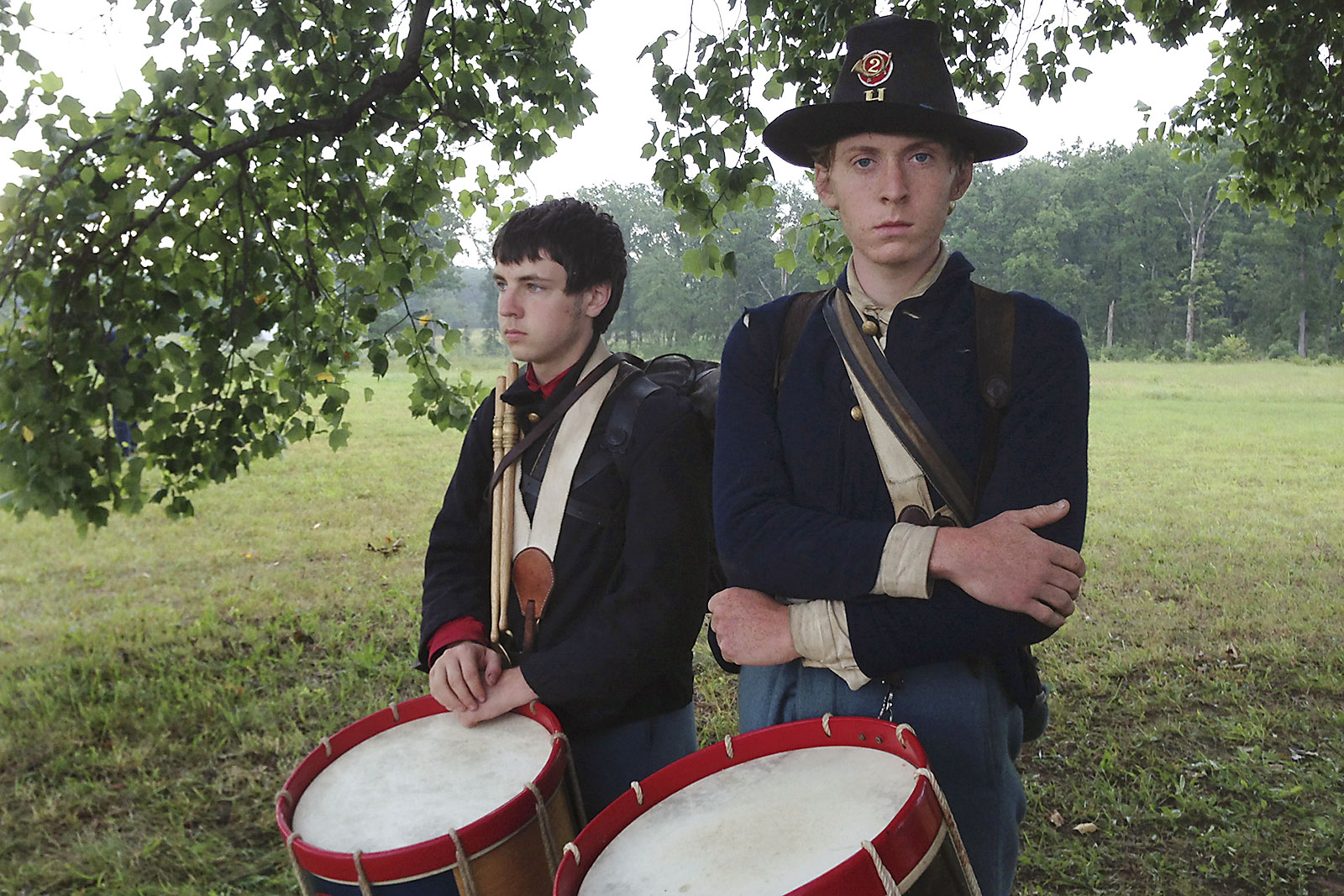 Two members of a drum and fife corps stand ready to play during a living history demonstrations at Gettysburg National Military Park.