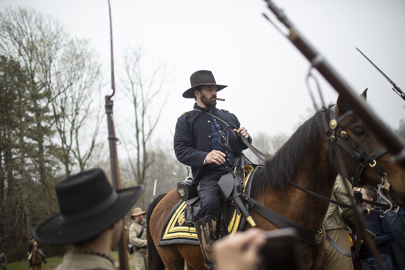 Gen. Grant reeanctor Curt Fields rides past Confederate reenactors at Appomattox.
