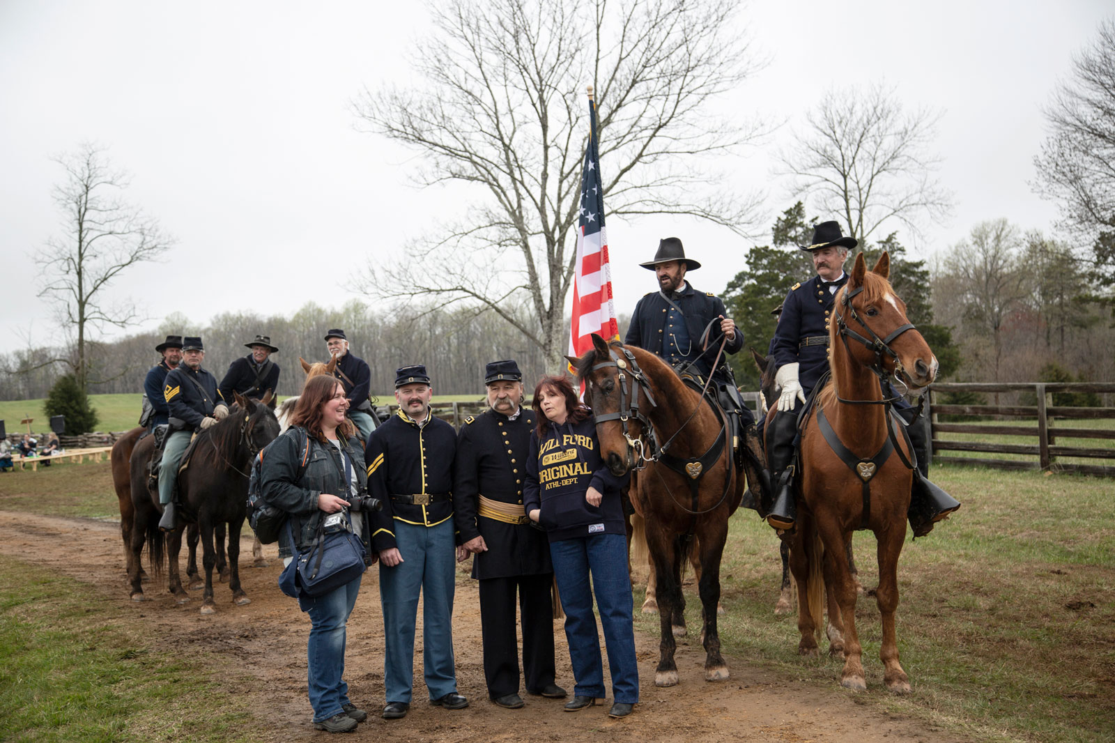 The horse of Gen. Grant reenactor, Curt Fields, brushes against a surprised tourist posing for a snapshot at Appomattox.