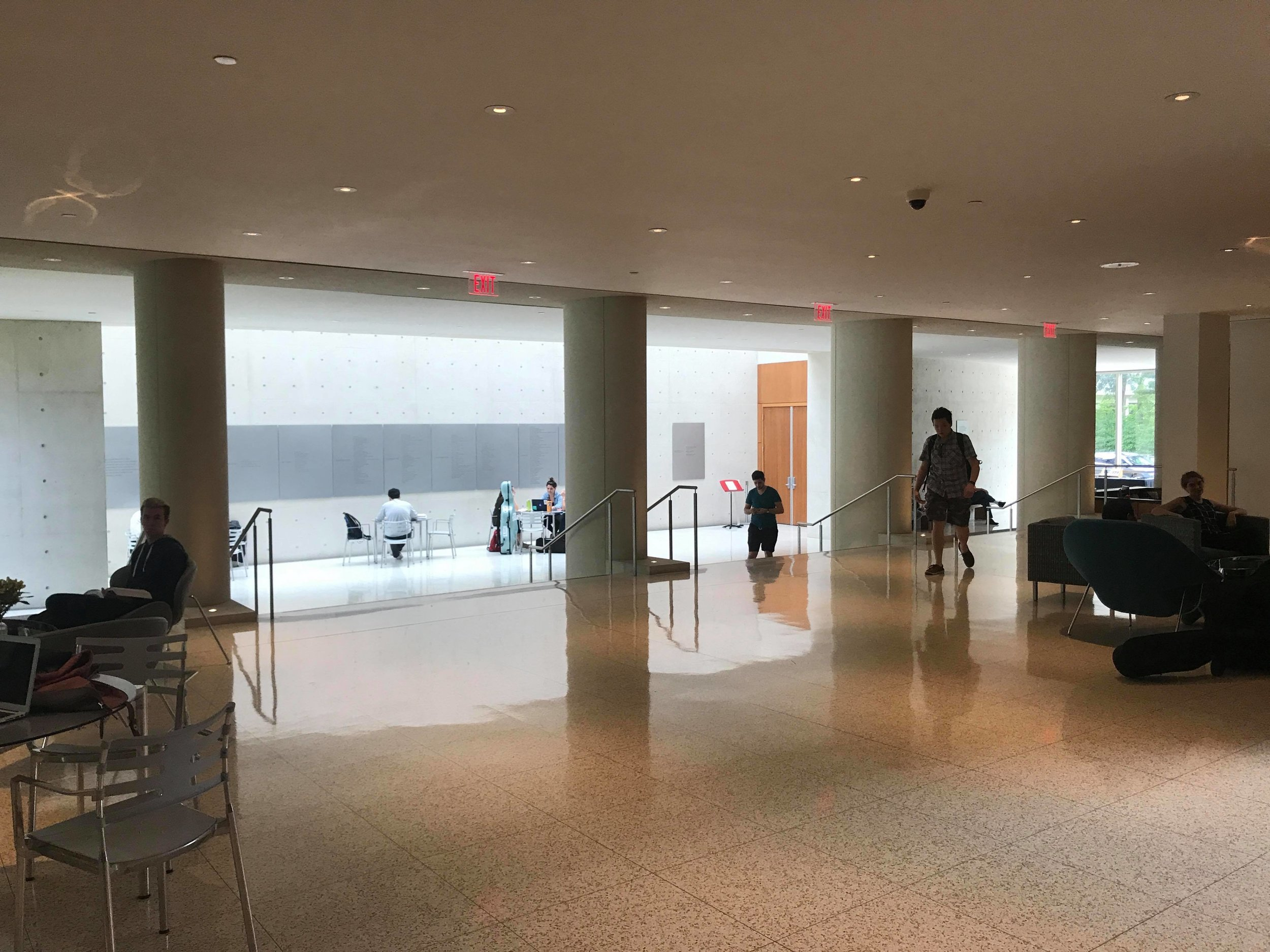 Pogue lobby; The double doors lead to Mixon Hall, where a majority of recitals and chamber music concerts take place. The elongated metal fixture on the wall contains many of the donors' names in which the Institute is indebted to.