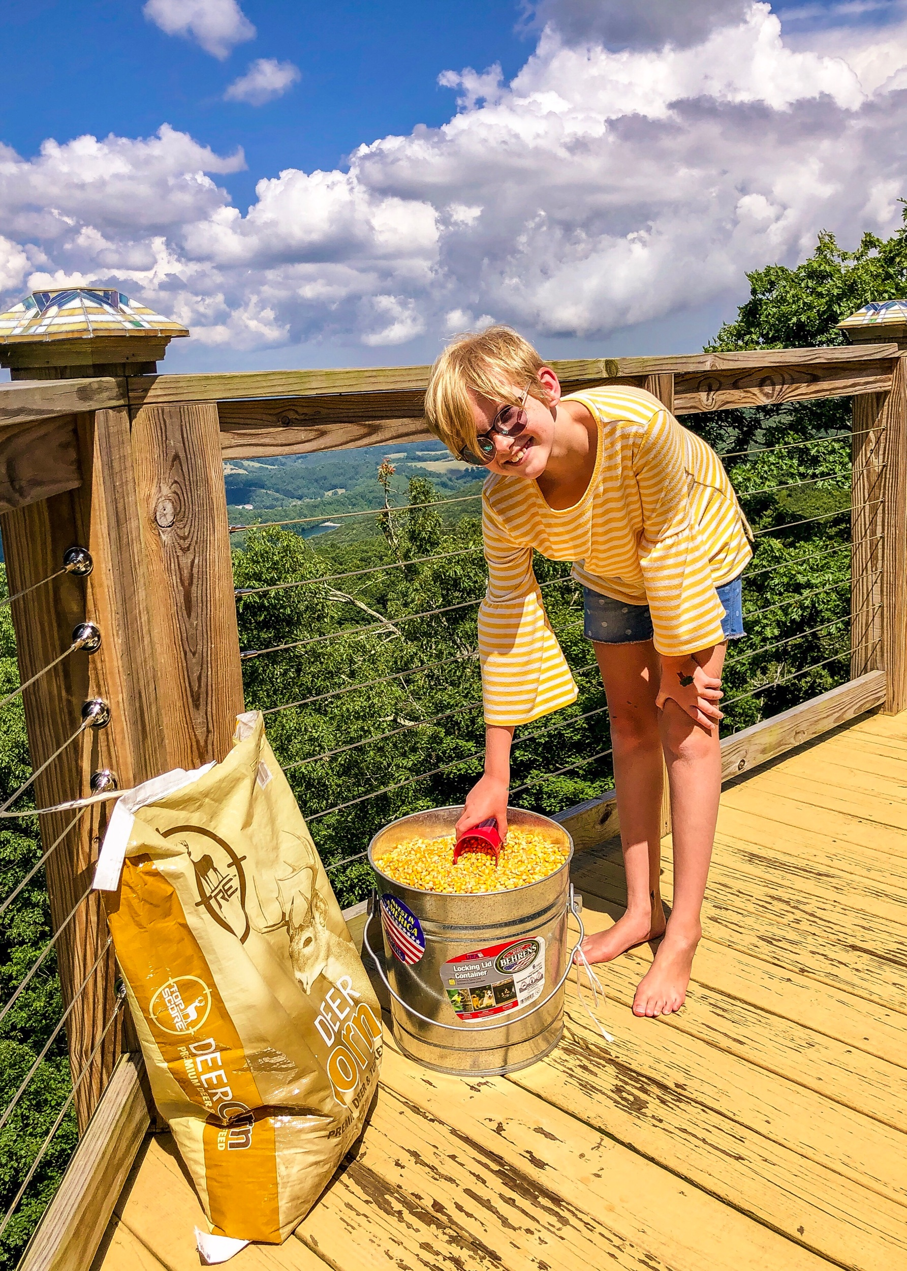 "Ally filling up the deer feeding station in anticipation of our ""friends"" coming back to visit."