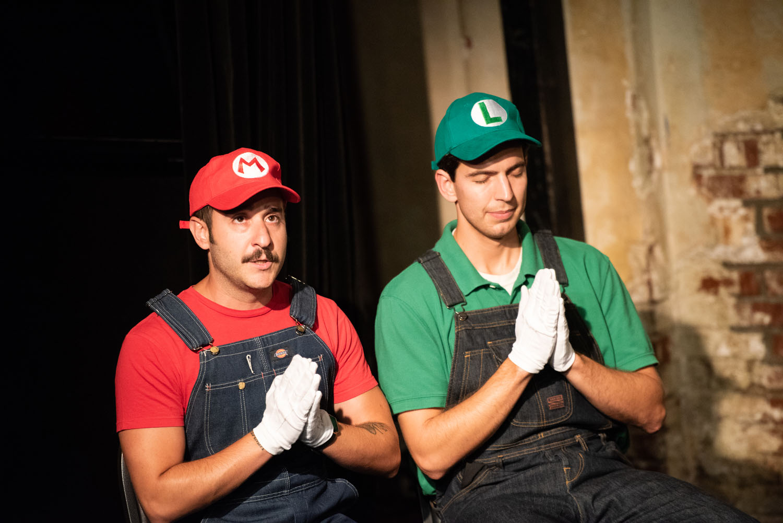 "Mario (Greg Santos) and Luigi (Andrew Heder) say grace in ""Super Mario Family Dinner"""