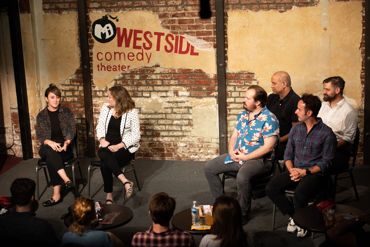 """Jill (Alisha Ketry) guests on Helen's (Jennifer Murray) show """"Who Needs A Man?"""" watched by Max Crandall, Atul Singh, Greg Santos and Patrick Tamisiea"""