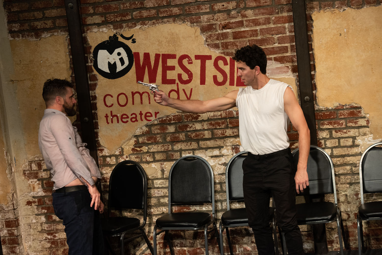 """Wet Kenneth (Patrick Tamisiea) dodges the shots from the commander (Andrew Heder) in """"Wet Kenneth #3"""""""