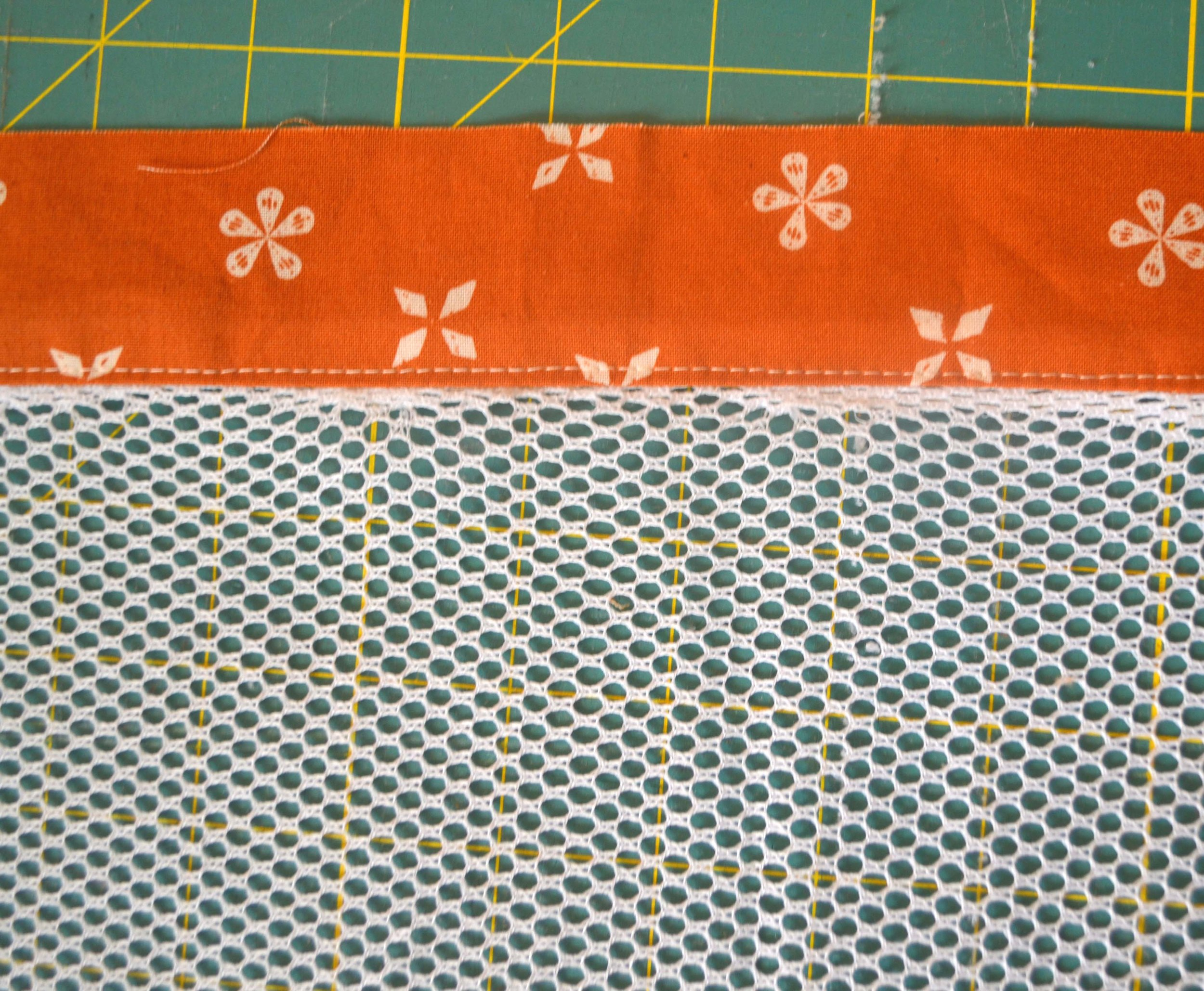 - 4. Flip the fabric up and press. If your mesh is polyester, remember to change your iron setting.5. With the right side of the cotton fabric facing up, topstitch.
