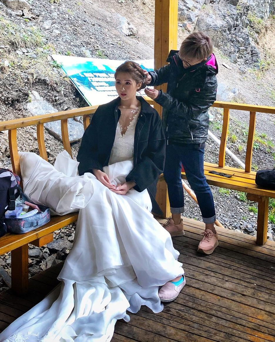 Sarah doing some touch-ups to ensure that Andrea's hair is always picture perfect! The choice of elegant, braided updo exuded the classiness in the bride