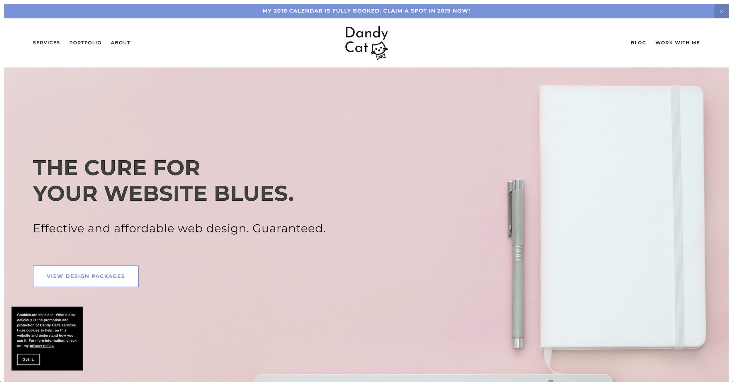 Then home page of the Dandy Cat Design website, featuring a cookie banner with white text on a black background.