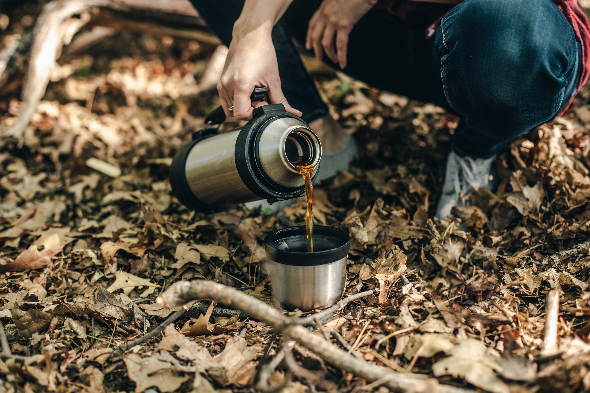 pouring-coffee-in-the-wilderness_4460x4460.jpg