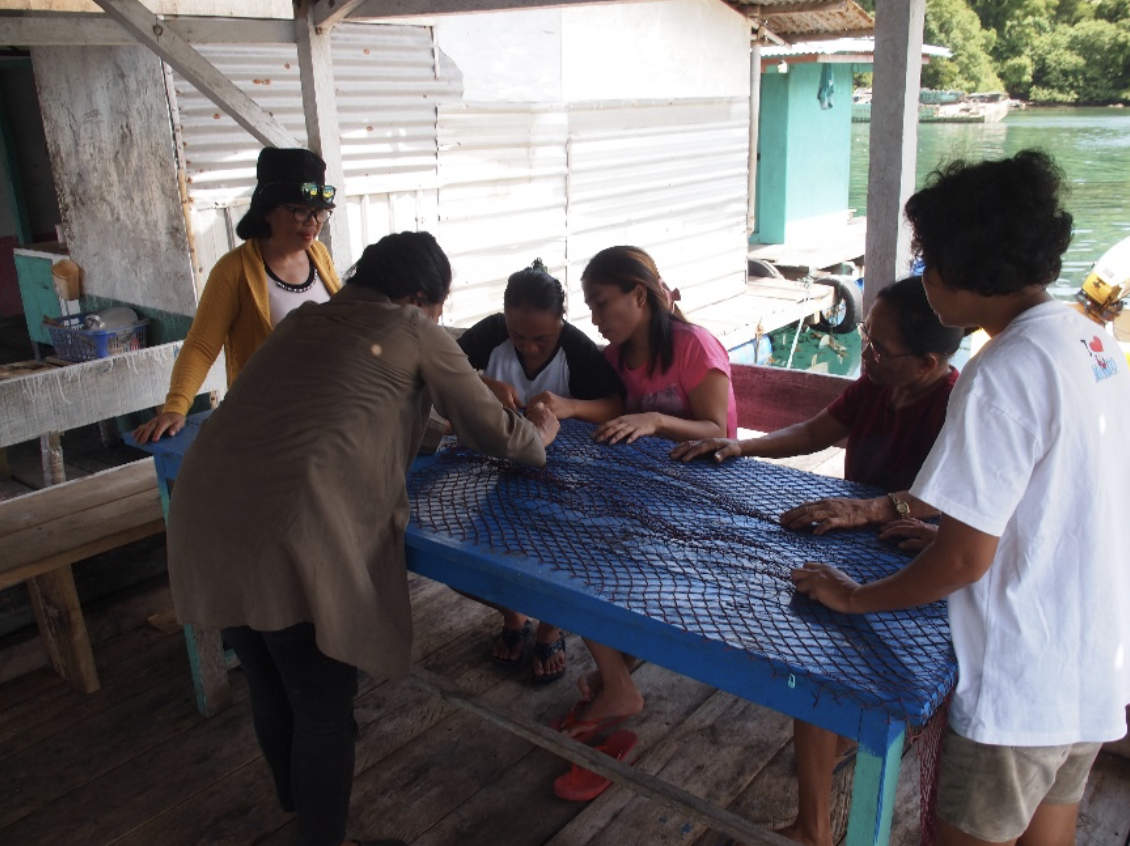 Lembeh Island's women learned how to cut the fishing nets.