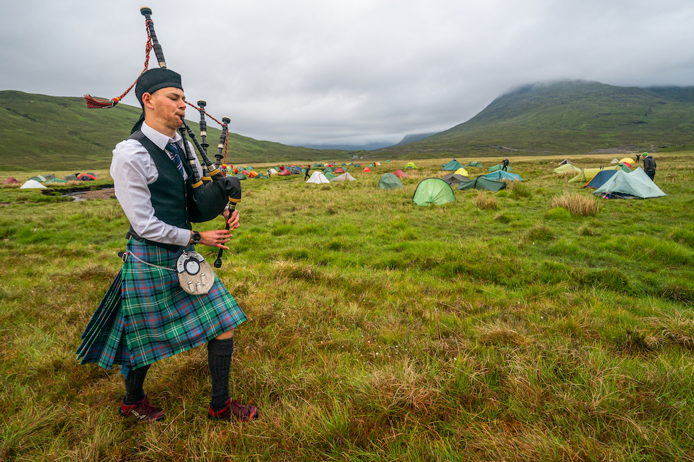 Louis MacMillan from Loch Eck Orienteers was on hand with his bagpipes to provide a very appropriate wake-up call on both mornings ©Steve Ashworth