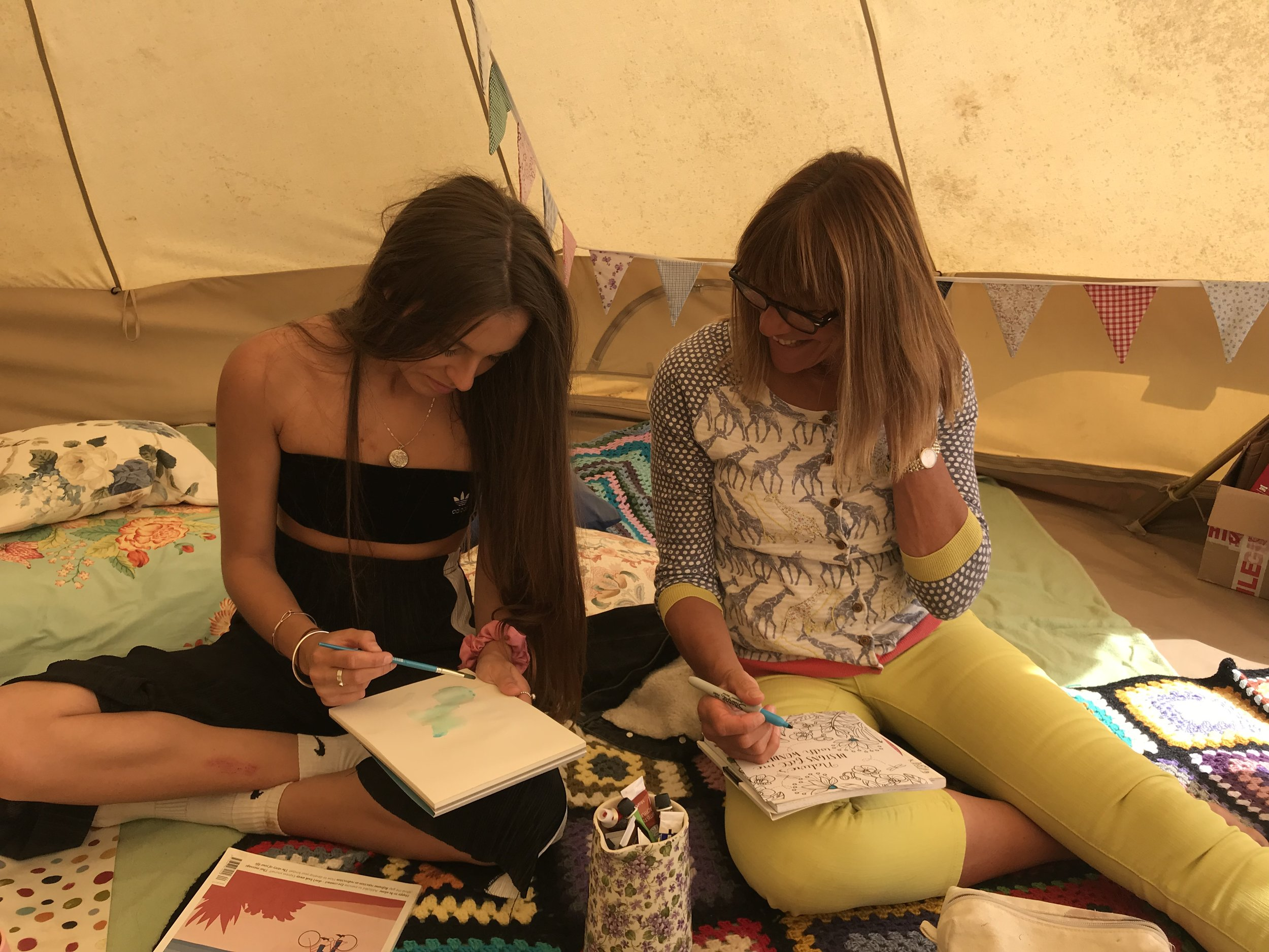 Mother and daughter enjoying some artistic relaxation together in the Well Tent.