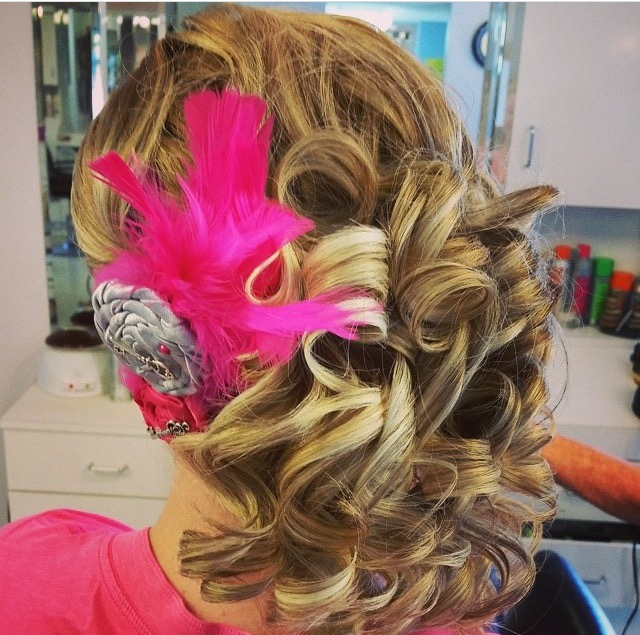 Formal - Ideal for a wedding or prom, this client had thick, course hair and wanted an up-do that would last through dancing the night away.