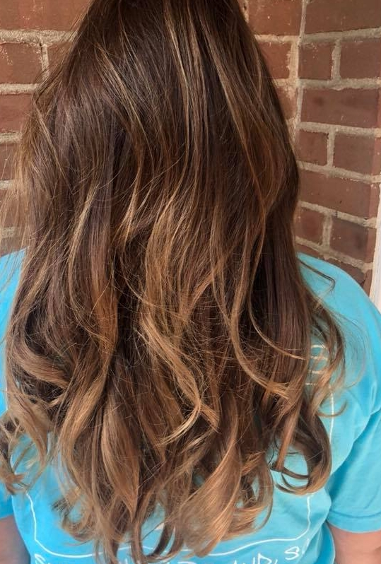 Balayage - Ideal for clients who want long lasting hair color. The service provides a darker root and a lighter end.