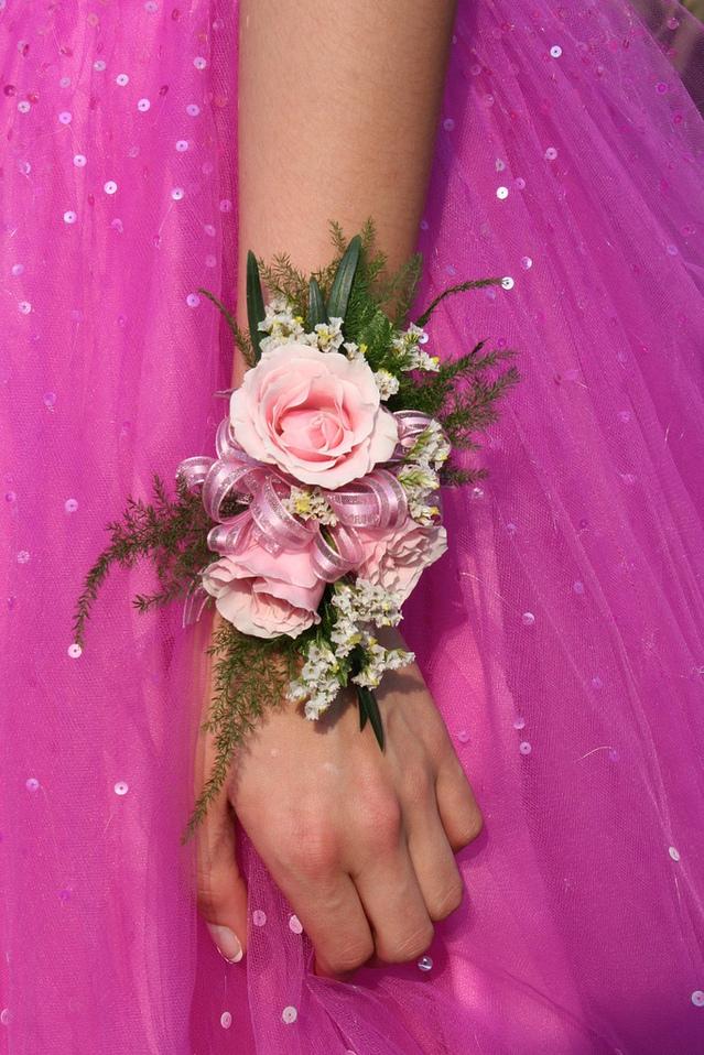 close-up-pink-dress-flower-arm-hand-1576956-639x958.jpg