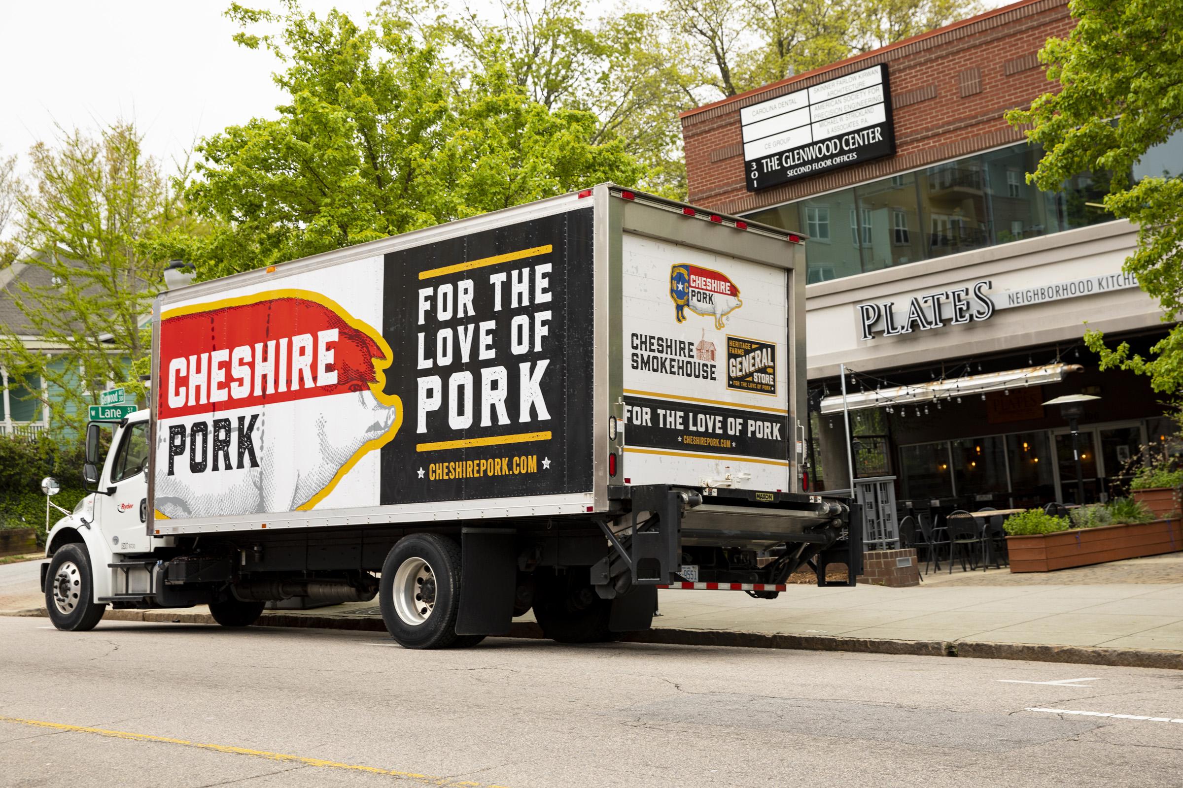 Cheshire Pork Half Hog gets delivered a day prior for a 14-hour white oak smoke.