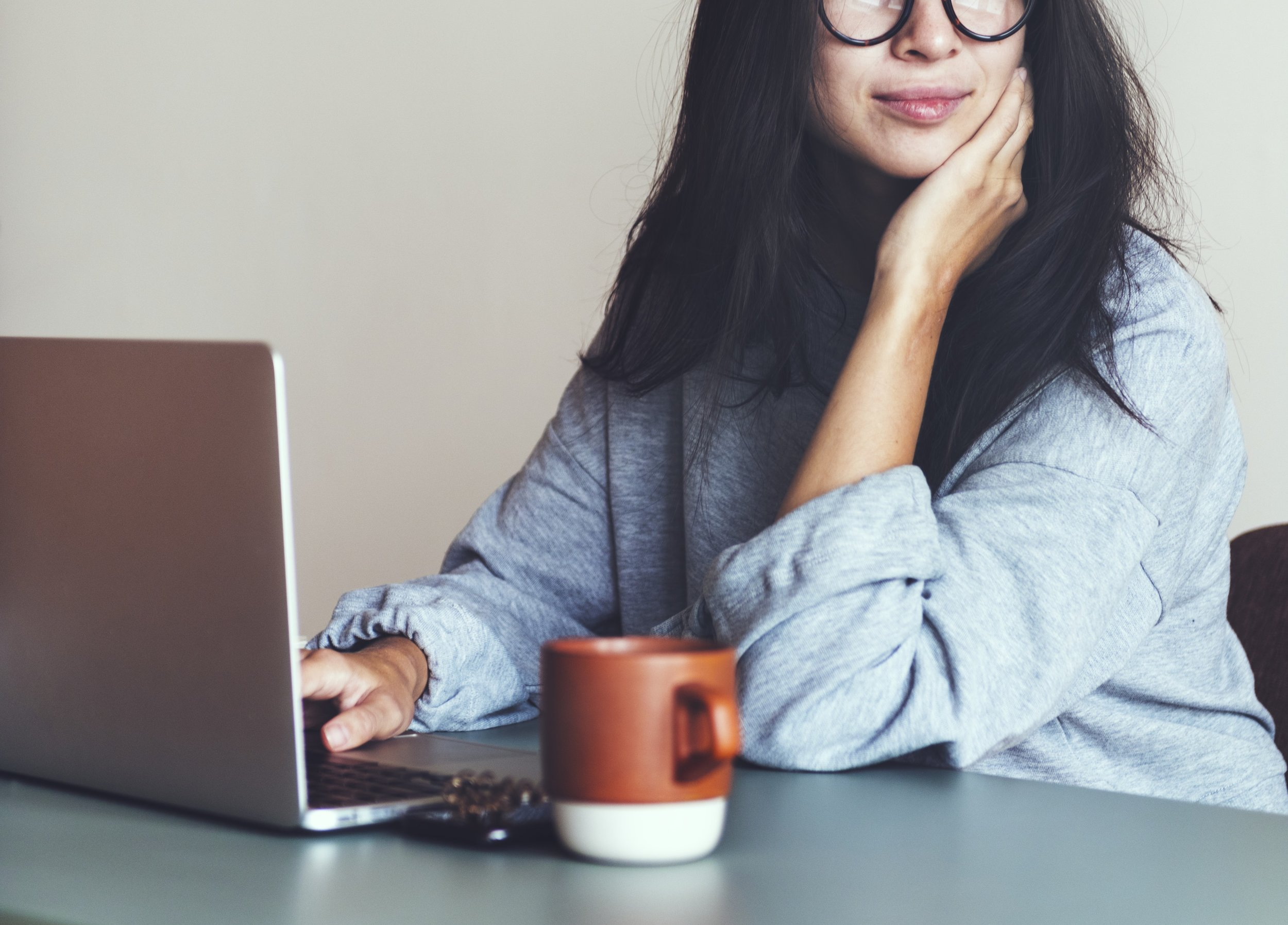 July blog content - woman by a computer.jpg