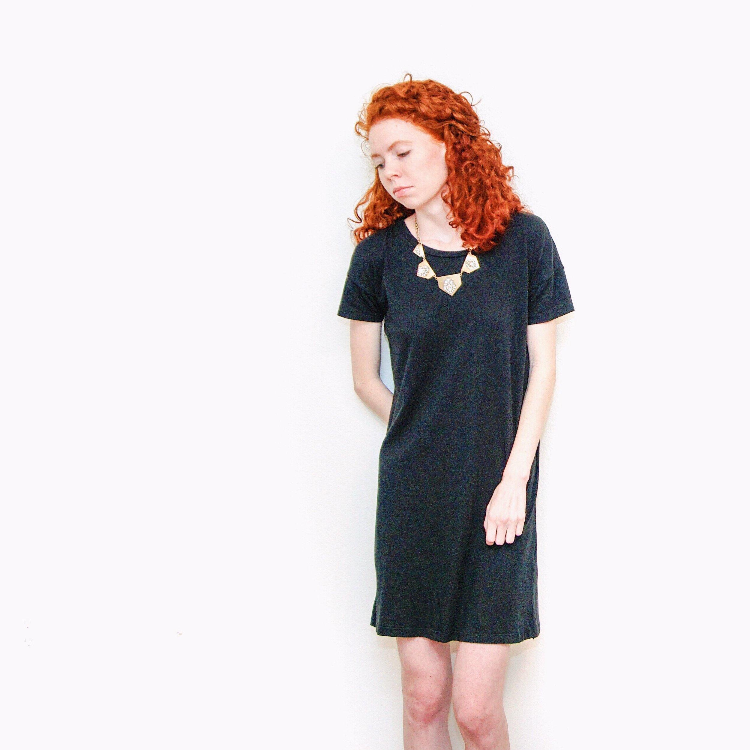 girl-in-black-shift-dress