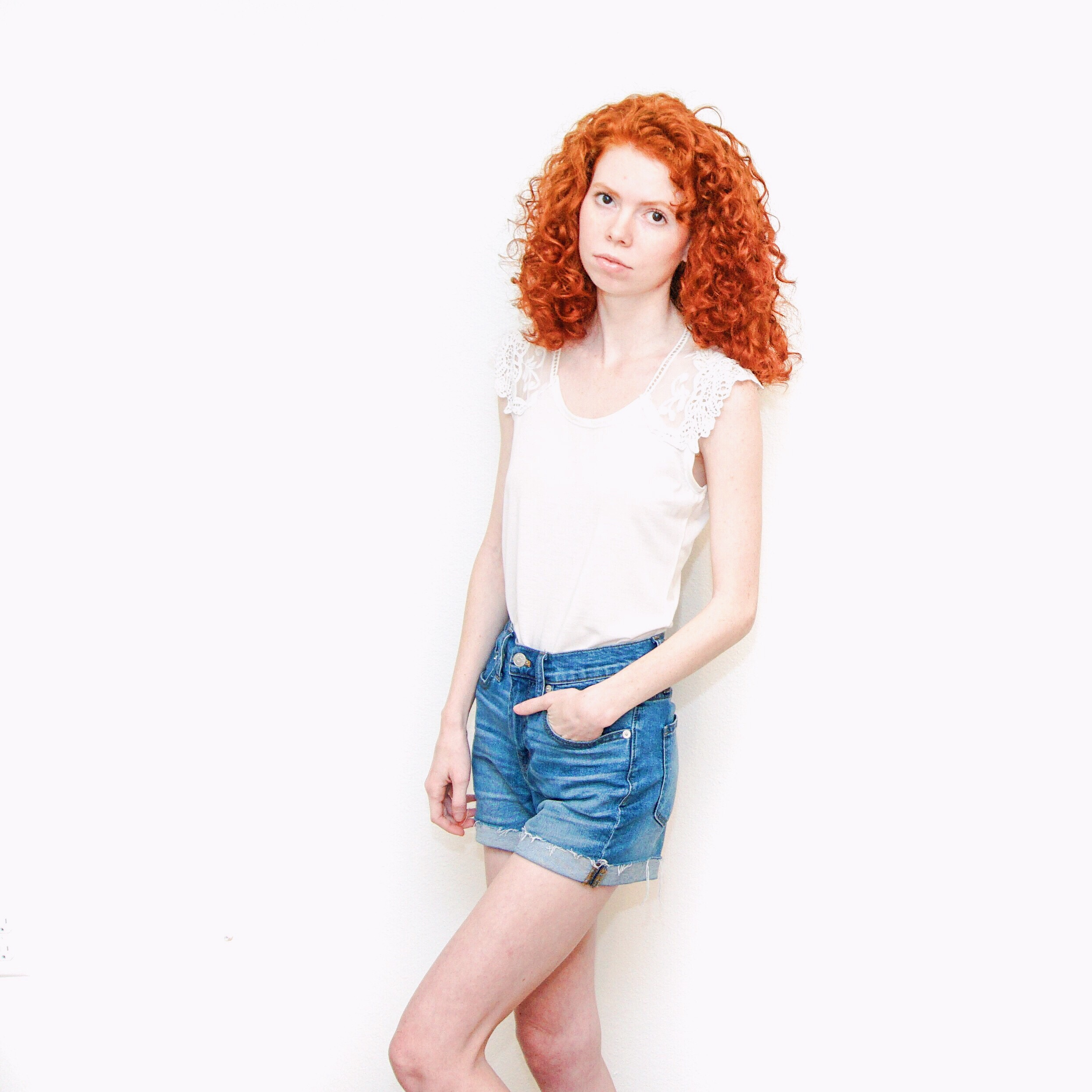 girl-in-jean-shorts-and-white-lace-tee