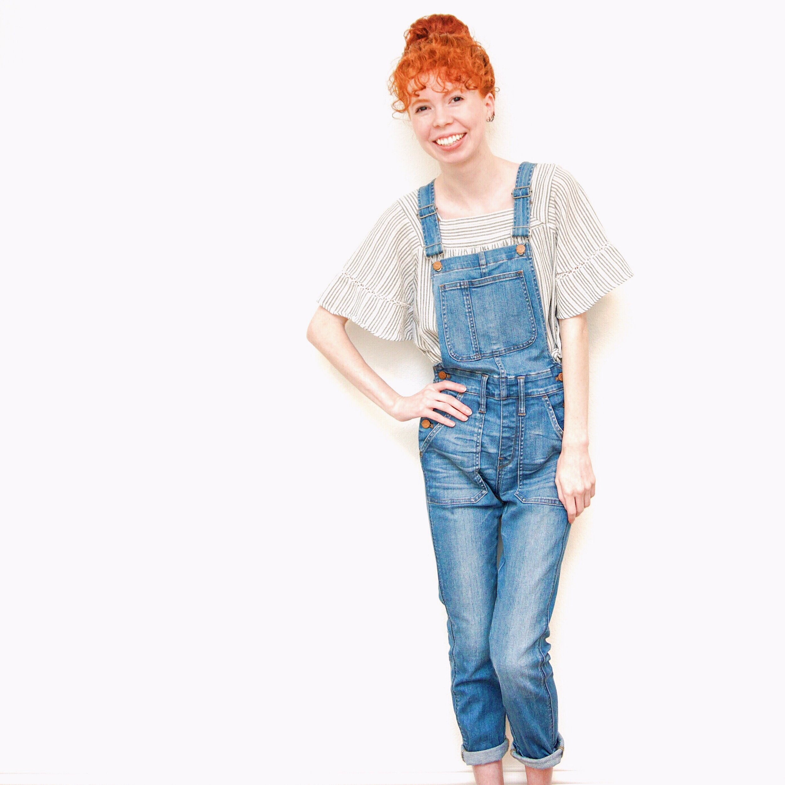 girl-in-overalls-stripe-top