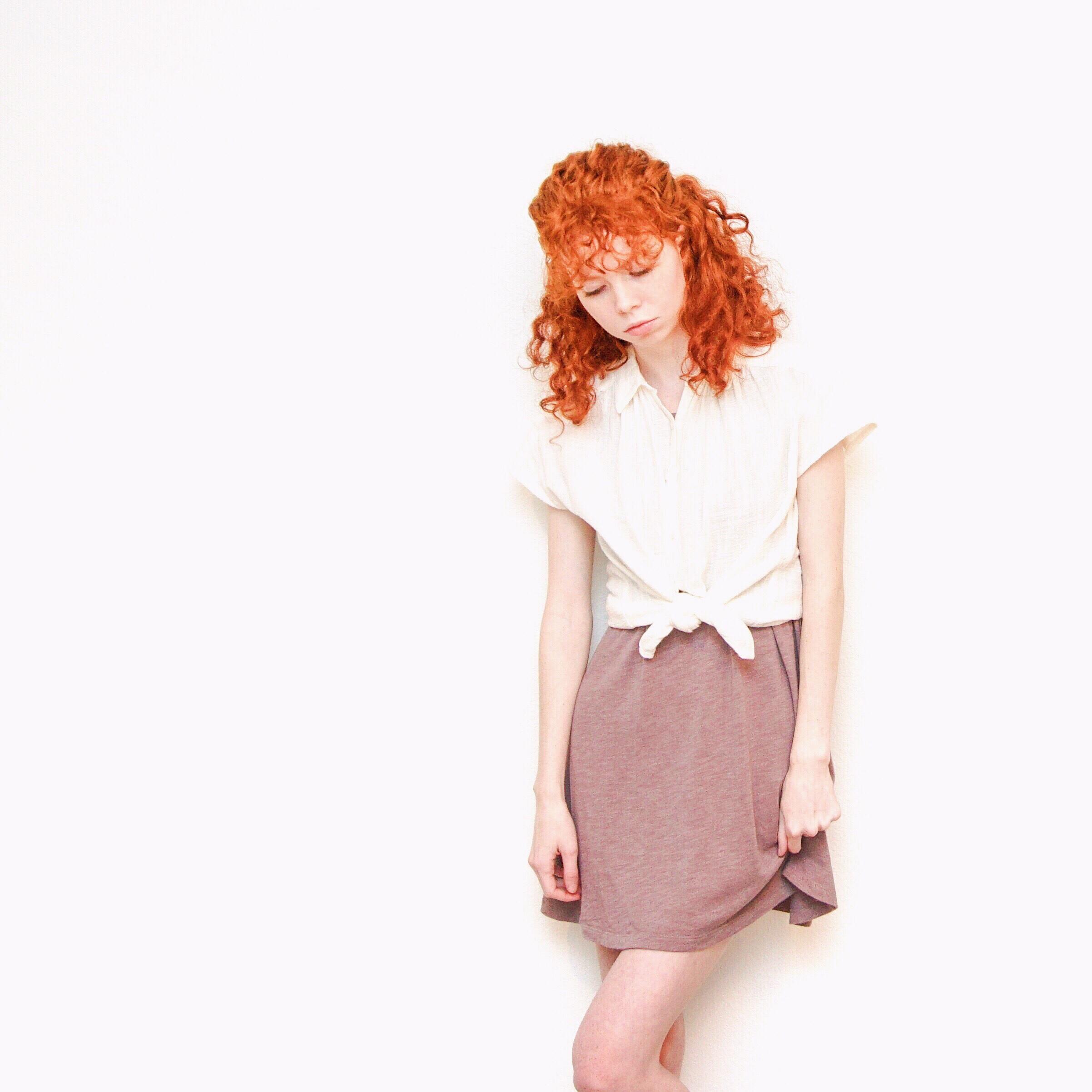 girl-in-white-blouse-purple-skirt
