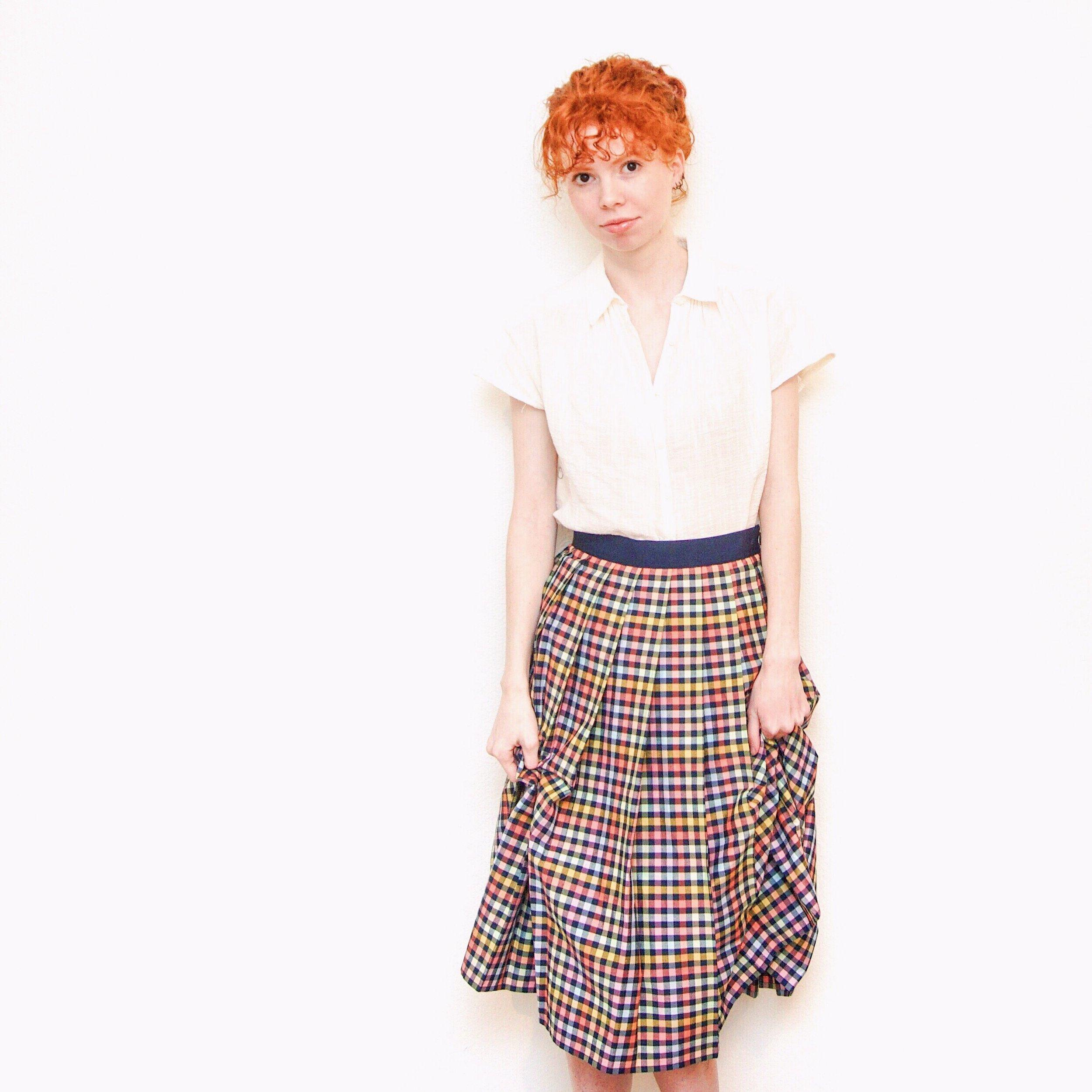 girl-in-white-blouse-check-midi-skirt