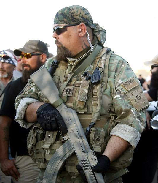 """sonofbaldwin :     Photo of white folk at the  """"peaceful"""" protest  in Phoenix, Arizona outside of the mosque.  Chile.  Can you IMAGINE if black, Latin@, Native American, and/or Muslim people showed up to a protest armed like this?   Can you imagine how many police officers would have felt """"threatened"""" and murdered protesters indiscriminately?  Can you count the number of white people and white supremacy apologists who are going to reblog this along with their myriad of excuses for why this isn't an example of the grand hypocrisy of white supremacy?"""