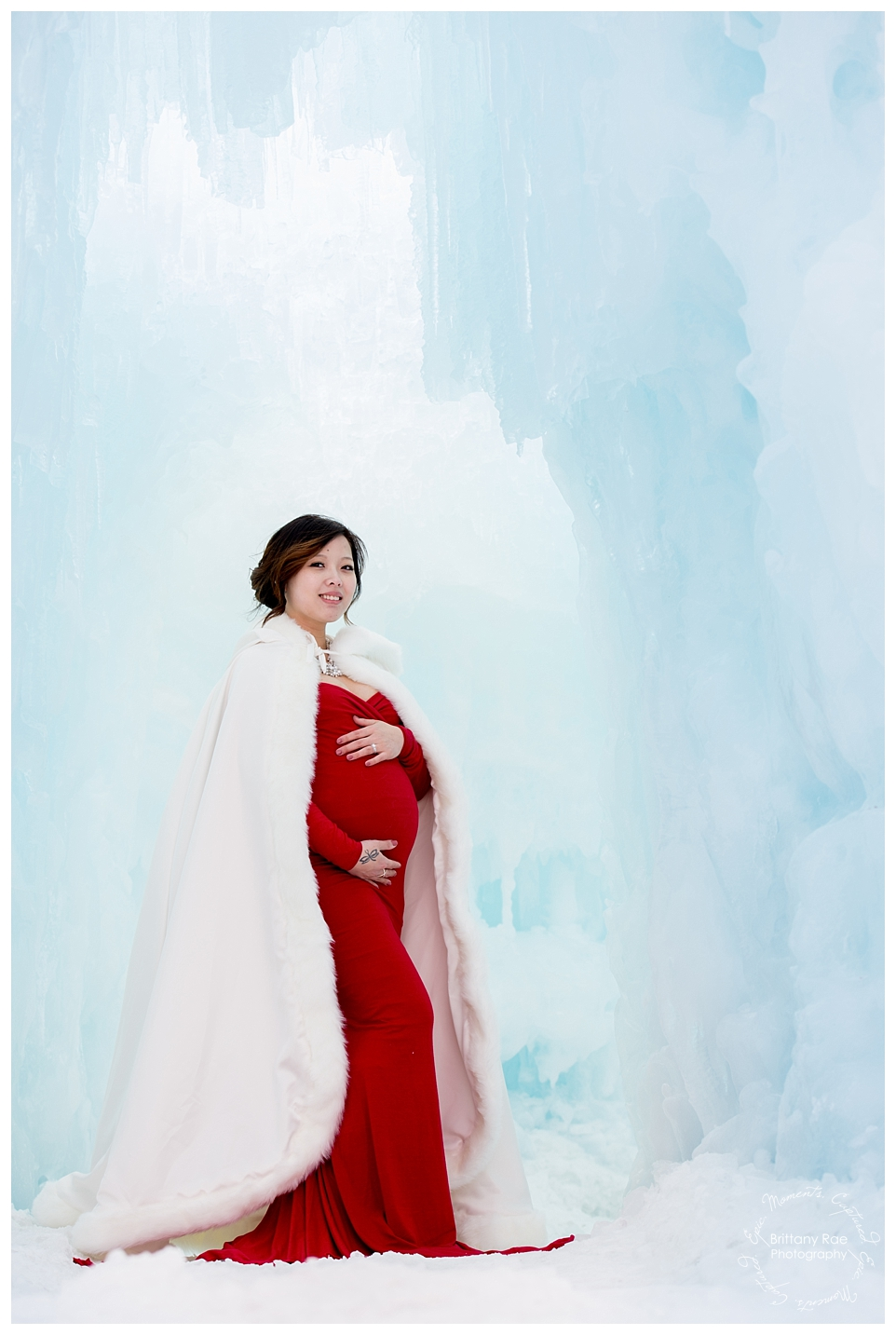 Ice Castle Maternity Photos in Lincoln New Hampshire by Maternity Photographer -
