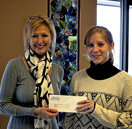 Bank of Ruston presenting NCLAC with a sponsorship check.