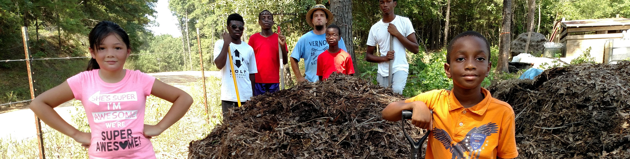 campti-field-of-dreams-building-compost-pile-e1522728657750.jpg