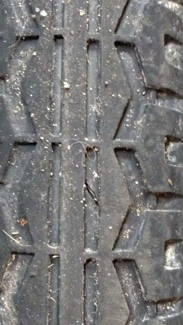 Hidden piece of glass in tread of tire