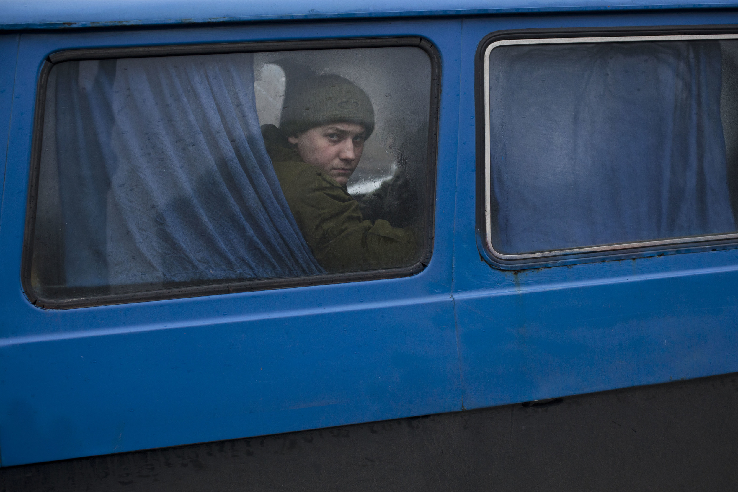 A volunteer with a self defense group looks out from a van near Kiev's Independence Square, Ukraine, Wednesday, March 5, 2014. (AP Photo/David Azia)