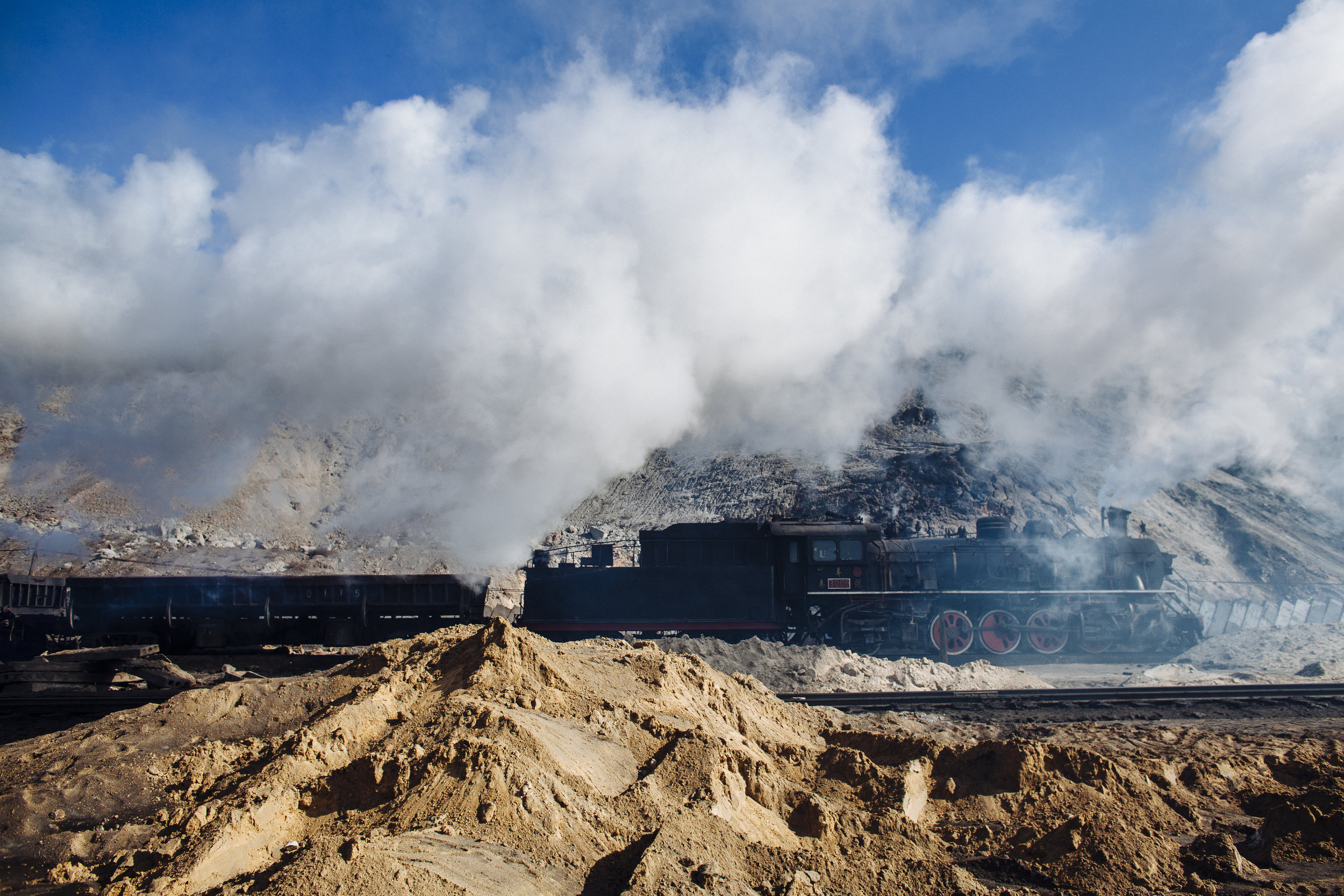 A steam locomotive makes its way inside the opencast coal mine in Zhalainuer, Inner Mongolia, China, Monday, March 23, 2009.