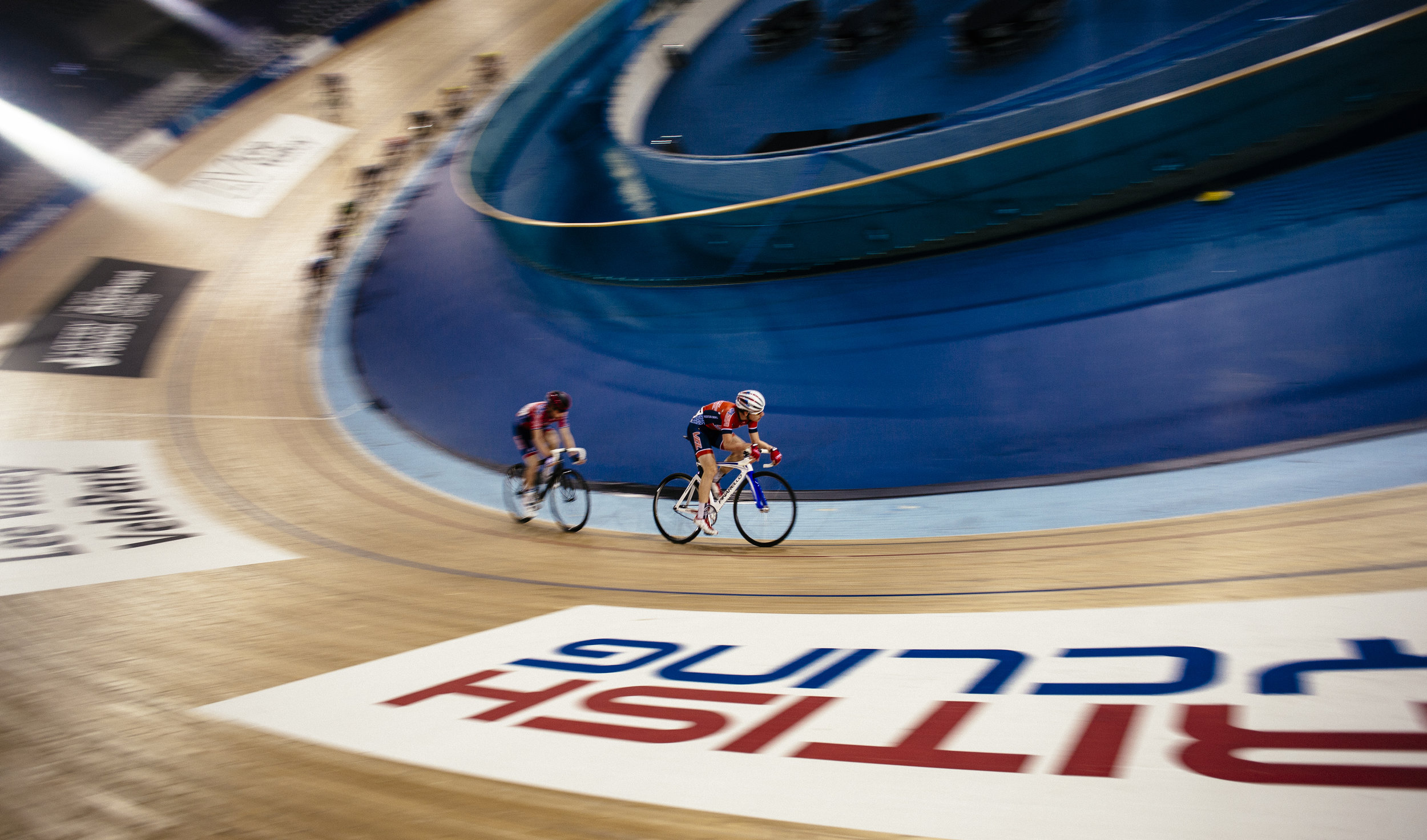 Competitors round the track during an amateur competition at the Lee Valley Velodrome, London, Tuesday, Dec. 1, 2015.