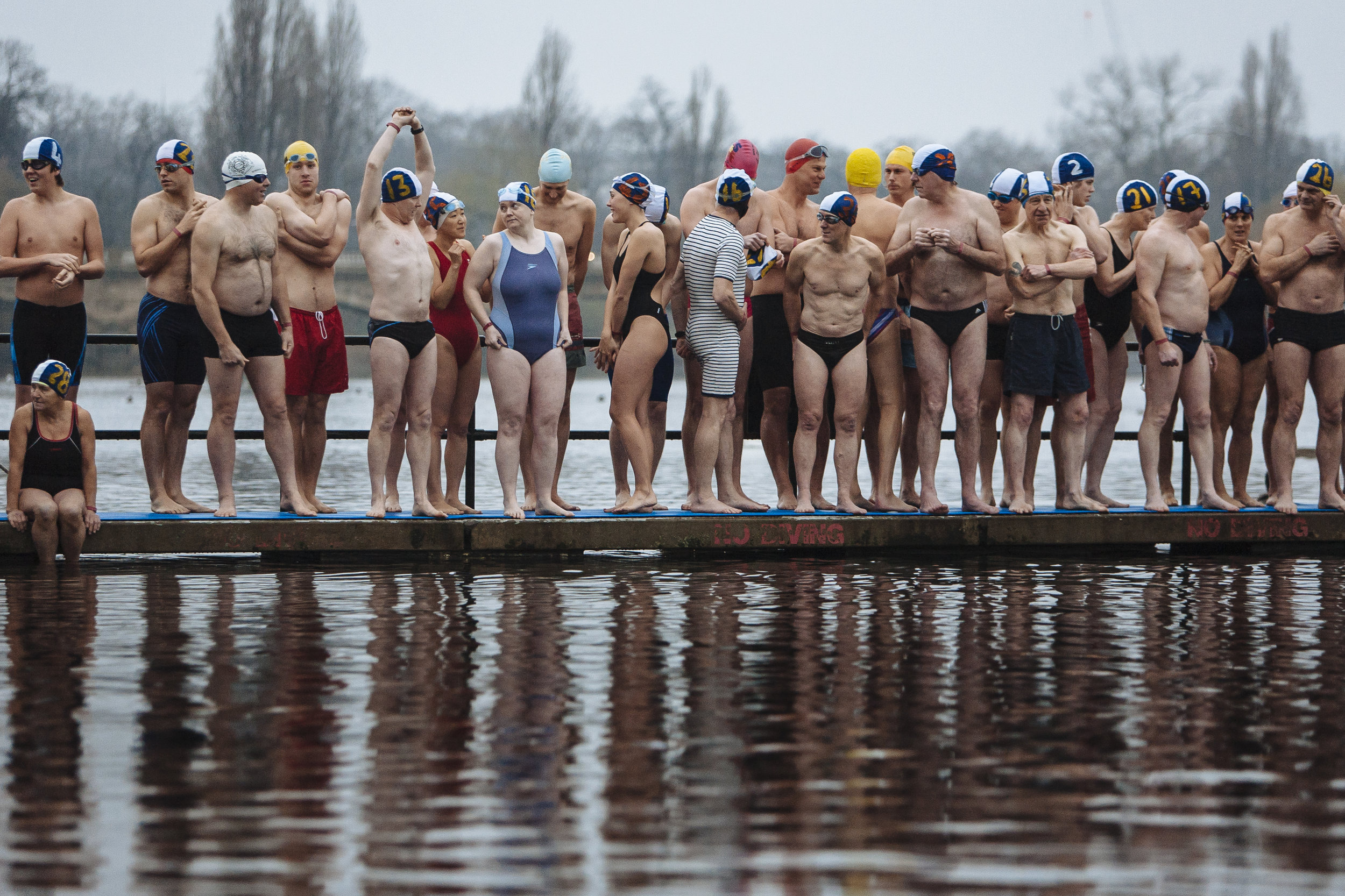 Members of the Serpentine swimming club line up for the traditional Christmas day swimming race in Hyde Park's Serpentine Lake, London, Tuesday, Dec. 25, 2007.