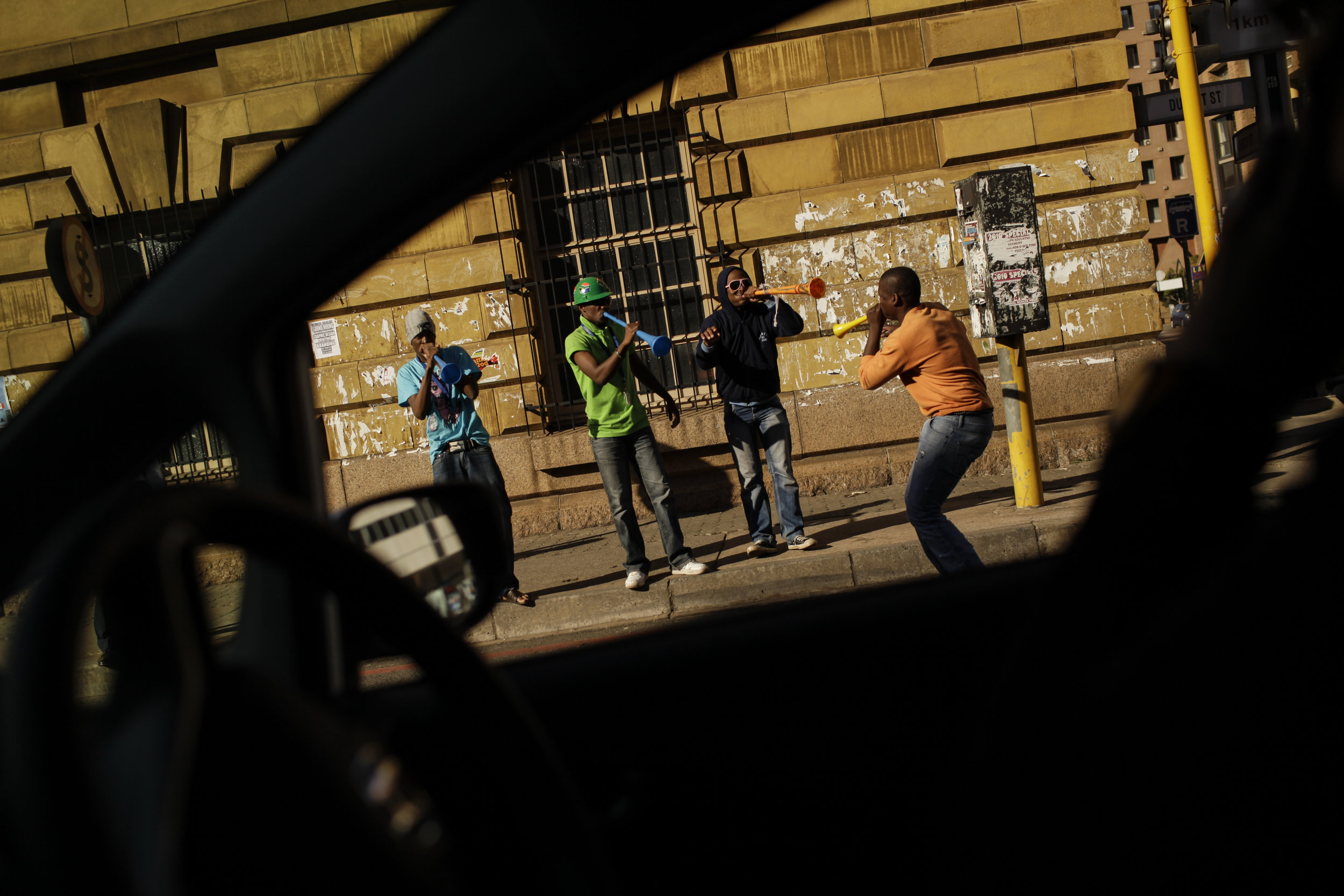 Soccer fans blow their vuvuzelas in downtown Pretoria, South Africa, Wednesday, June 16, 2010. (AP Photo/David Azia)
