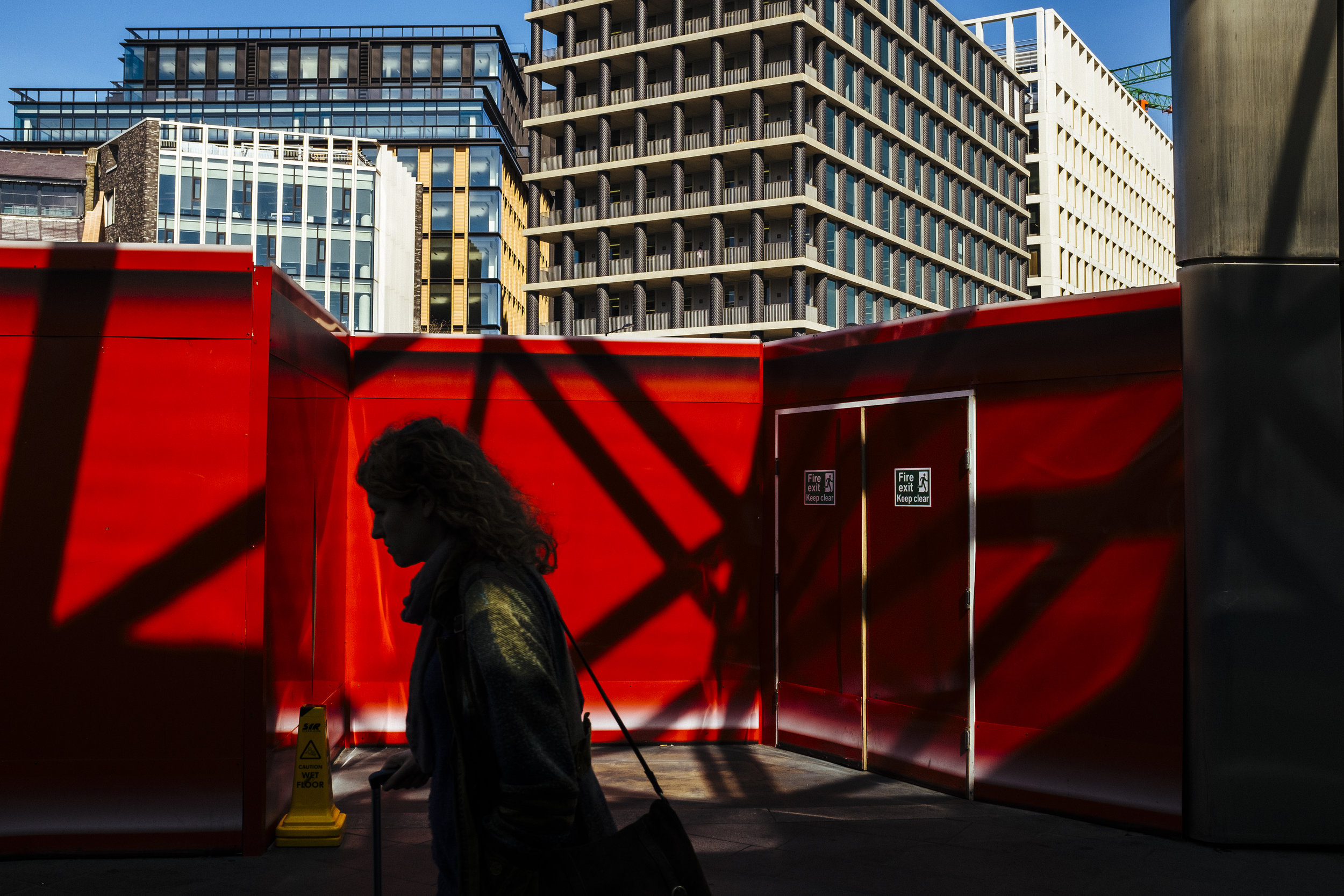 A person walks out of King's Cross railway station, London, England, Tuesday, April 14, 2015.