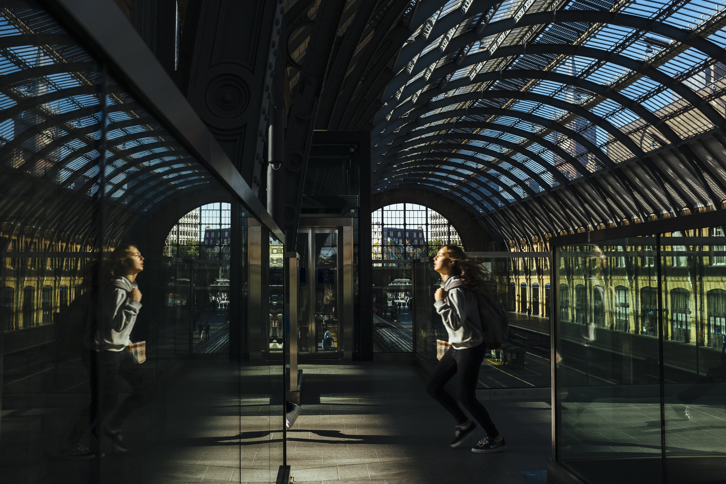 A passenger runs to catch a train at King's Cross railway station in London, Monday, Aug. 17, 2015.