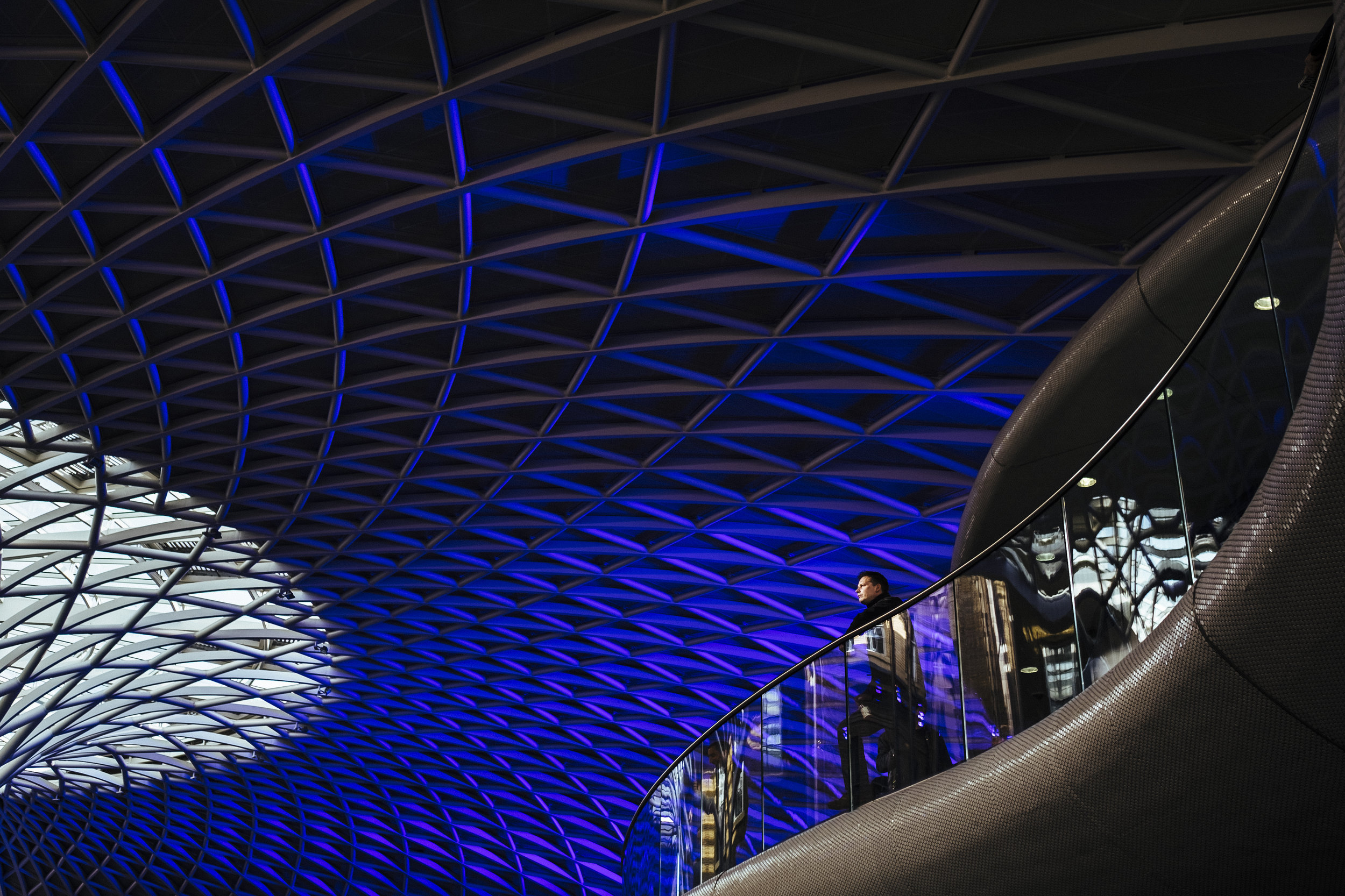 A person looks out from an elevated concourse at King's Cross railway station, London, Thursday, April 14, 2016.