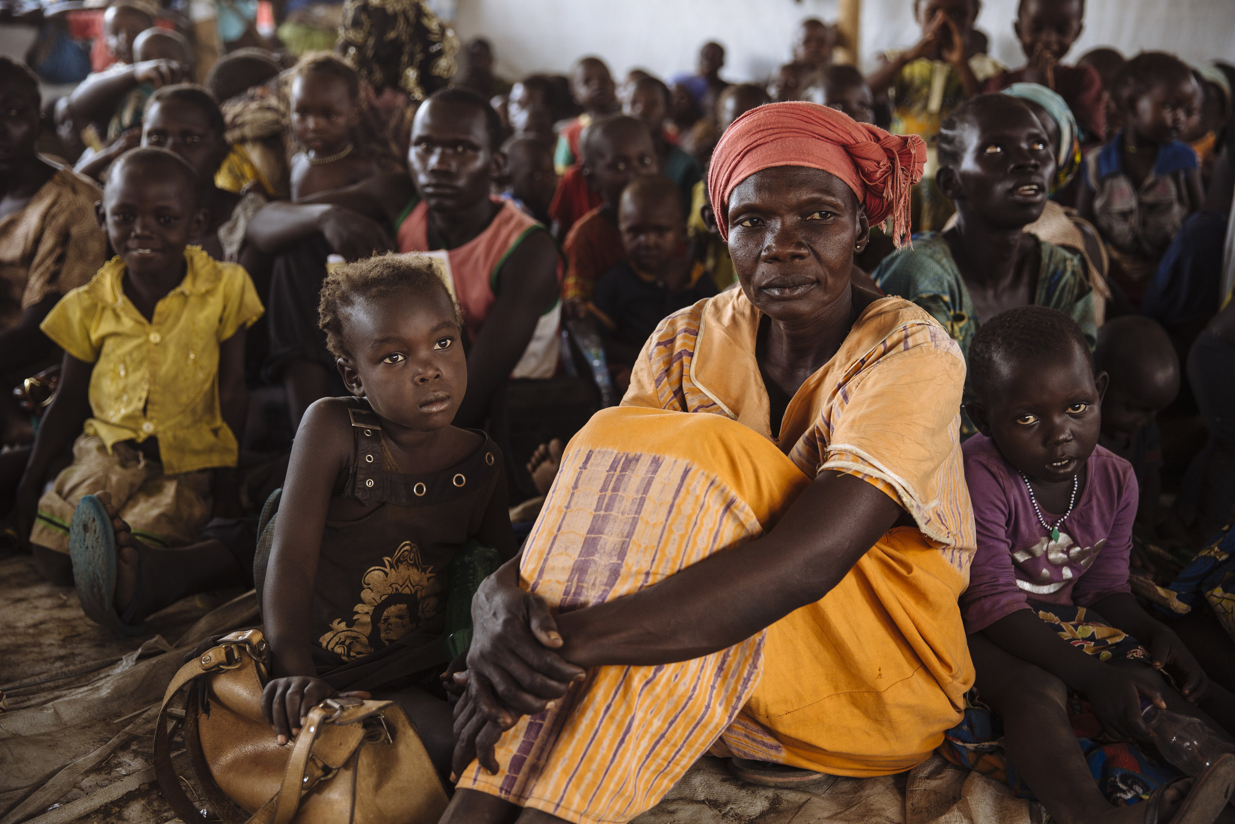 South Sudanese refugees wait to be registered at the Imvepi Reception Centre, Arua District, Northern Region, Uganda.