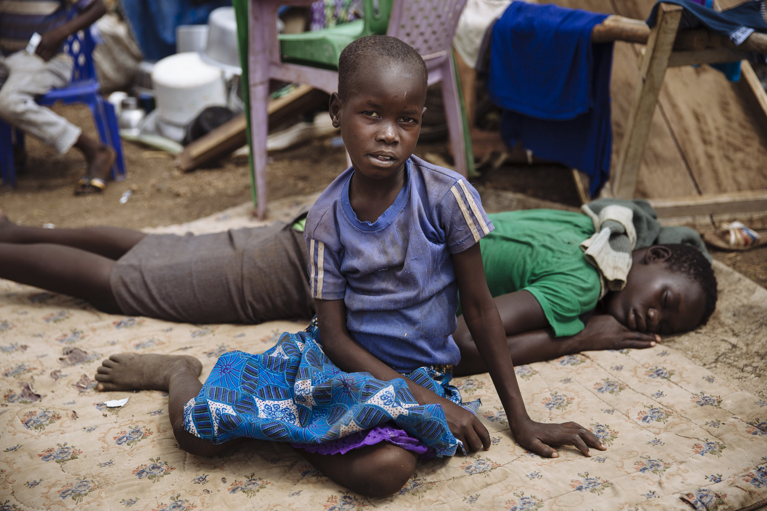 South Sudanese refugees rest on mattresses placed on the ground at the Imvepi Reception Centre, Arua District, Northern Region, Uganda.