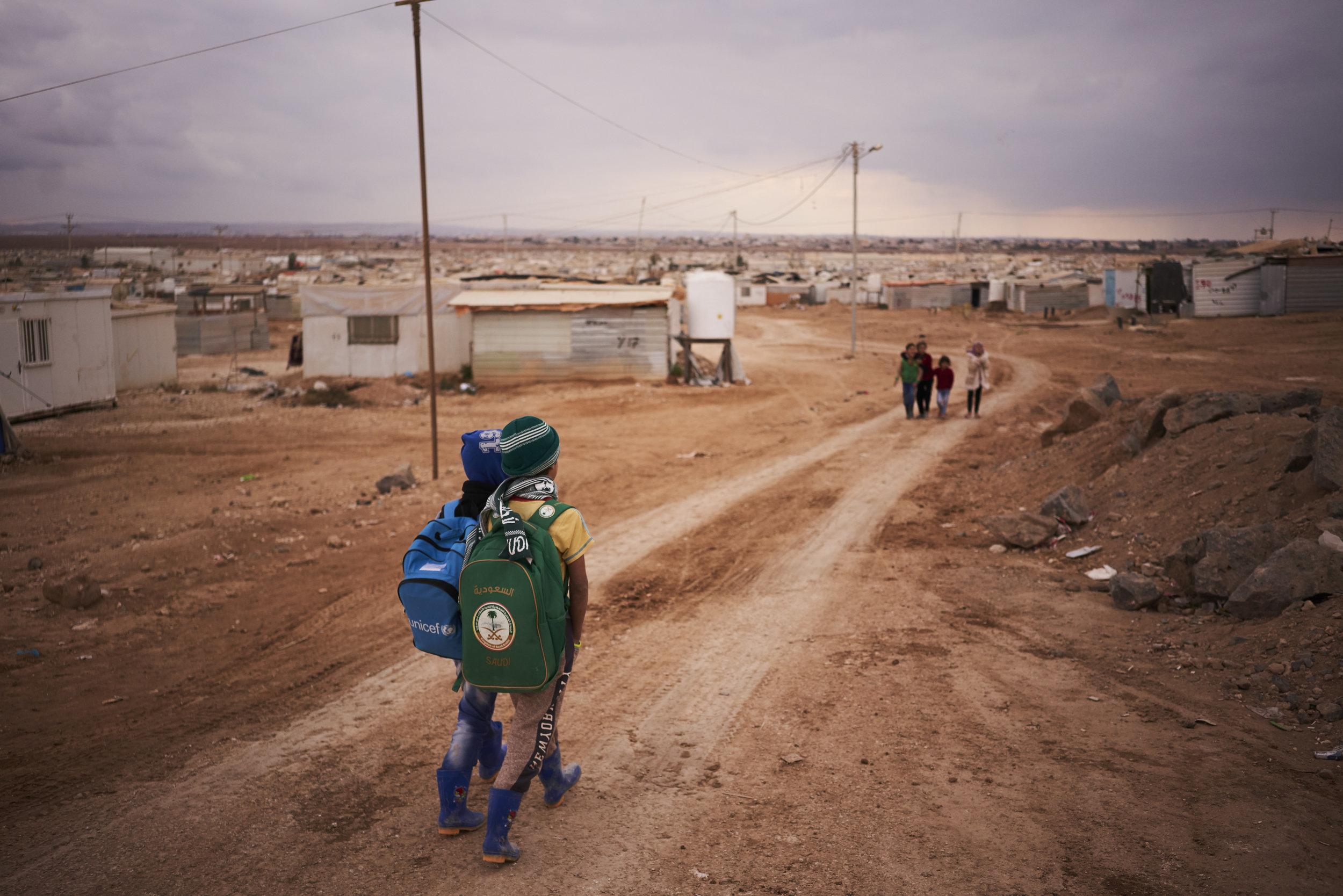Syrian refugee children make their way home from school in Zaatari refugee camp, Mafraq Governorate, Jordan.