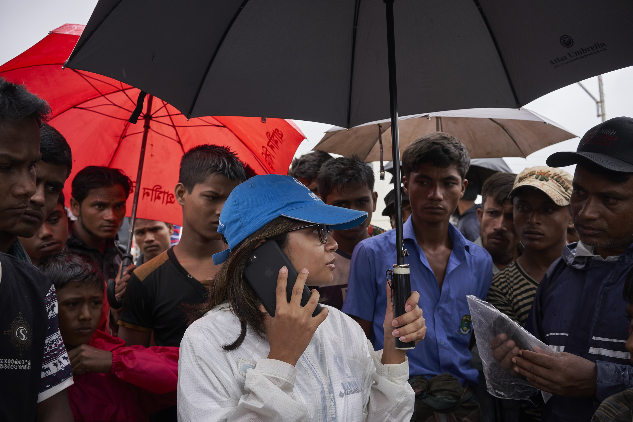 UNHCR Senior Field Associate Sarah Jabin, center, coordinates the relocation of 36 Rohingya refugee families, more than 150 people, from hazardous landslide and flood-prone zones to newly built shelters in an area that has been levelled, in Kutupalong Expansion Site for Rohingya refugees, Ukhia, Cox's Bazar District, Bangladesh.