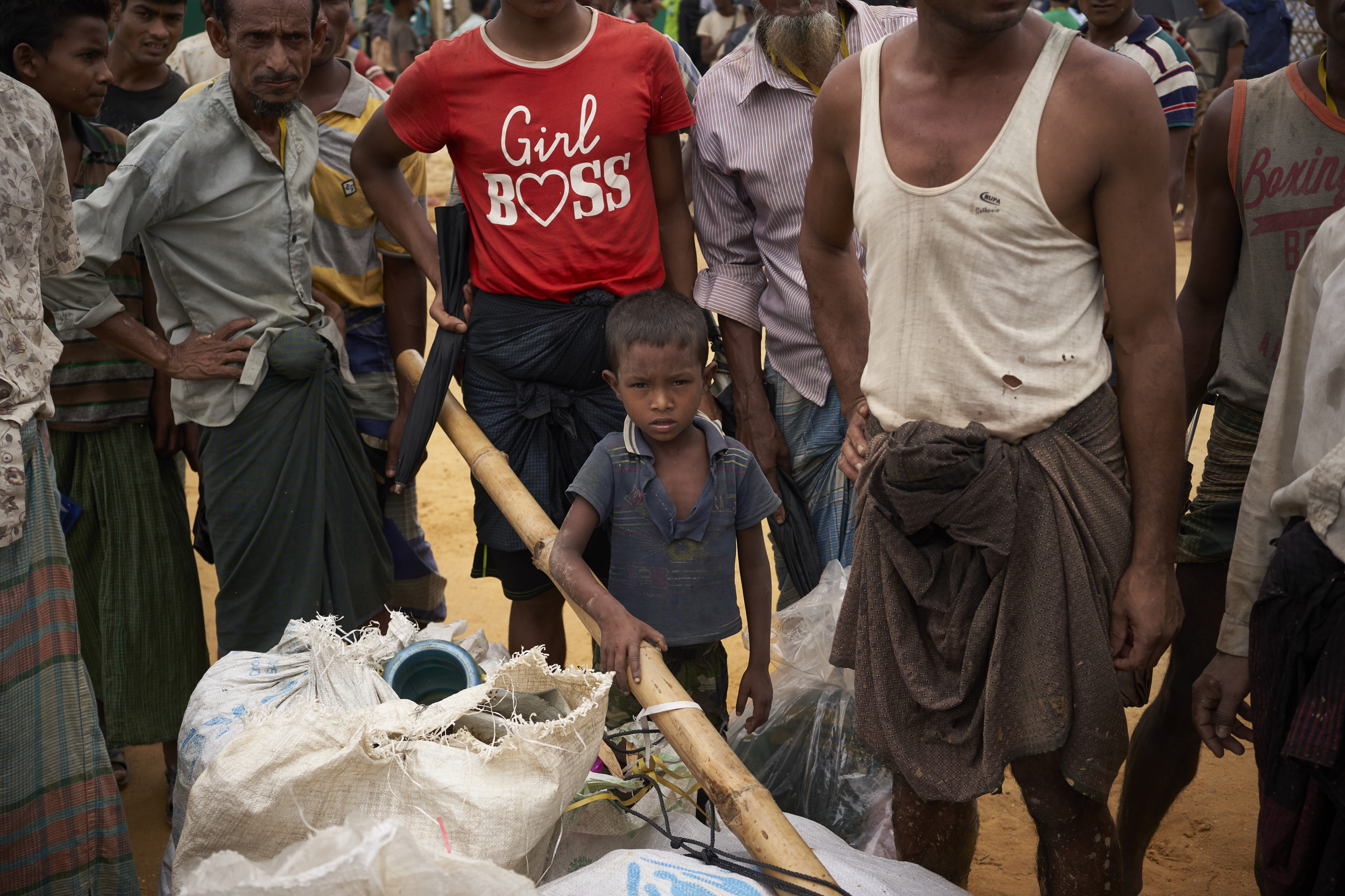 A Rohingya refugee child stands by items belonging to his family, one of 36 Rohingya refugee families, more than 150 people, being relocated from hazardous landslide and flood-prone zones to newly built shelters in an area that has been levelled, in Kutupalong Expansion Site for Rohingya refugees, Ukhia, Cox's Bazar District, Bangladesh.