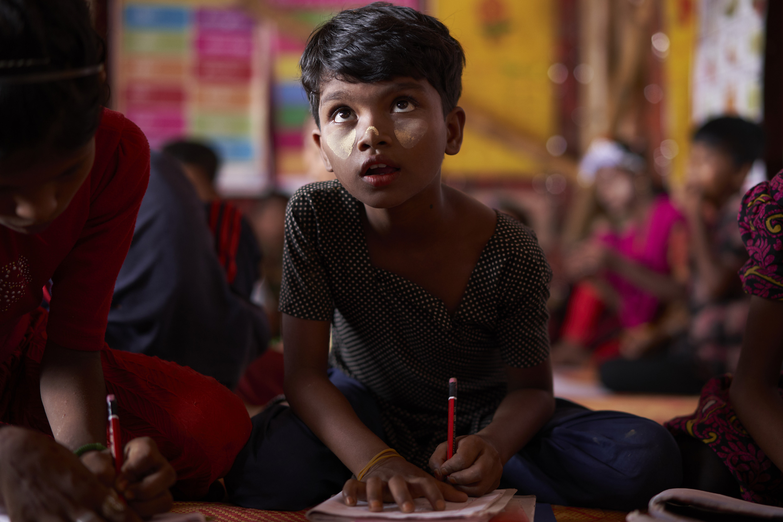A Rohingya refugee student attends an English class at the Protivar Bikash 1 learning center in Camp 4, at the Kutupalong Expansion Site for Rohingya refugees, Ukhia, Cox's Bazar District, Bangladesh.