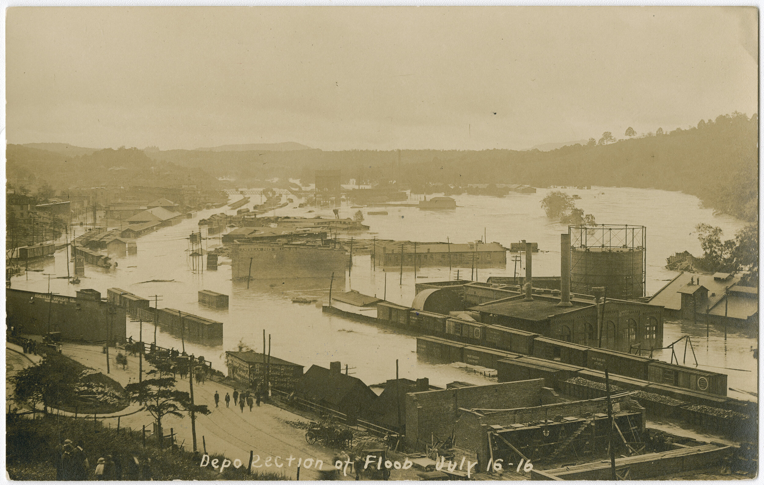 Postcard of the flood in the River Arts District from July 16, 1916. Looking from Haywood Road bridge south towards CURVE Studios.
